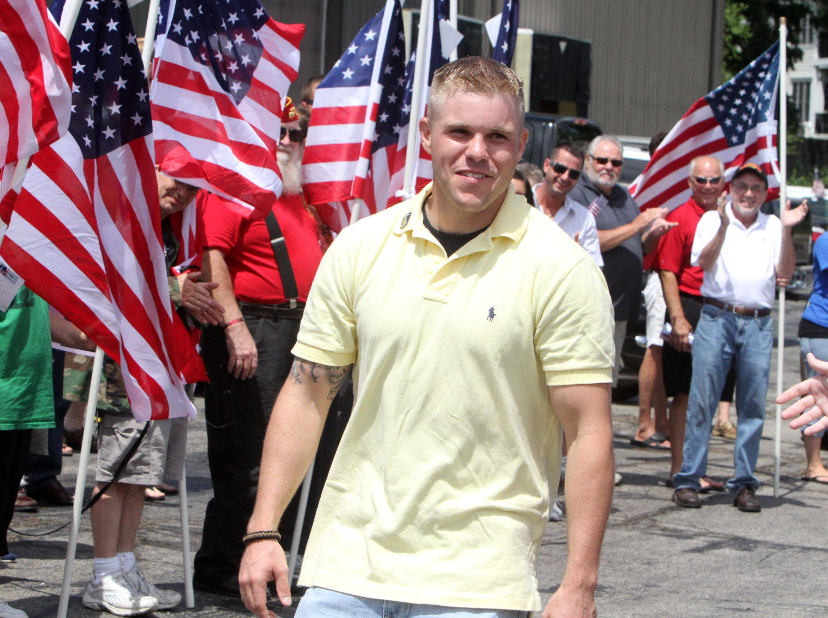 Libertyville resident Lance Corporal Kevin Cronin reacts to the large crowd that attended his homecoming parade which stepped off at Century Electric Supply in Libertyville and traveled west on Peterson Road to Austin�s Saloon and Eatery.