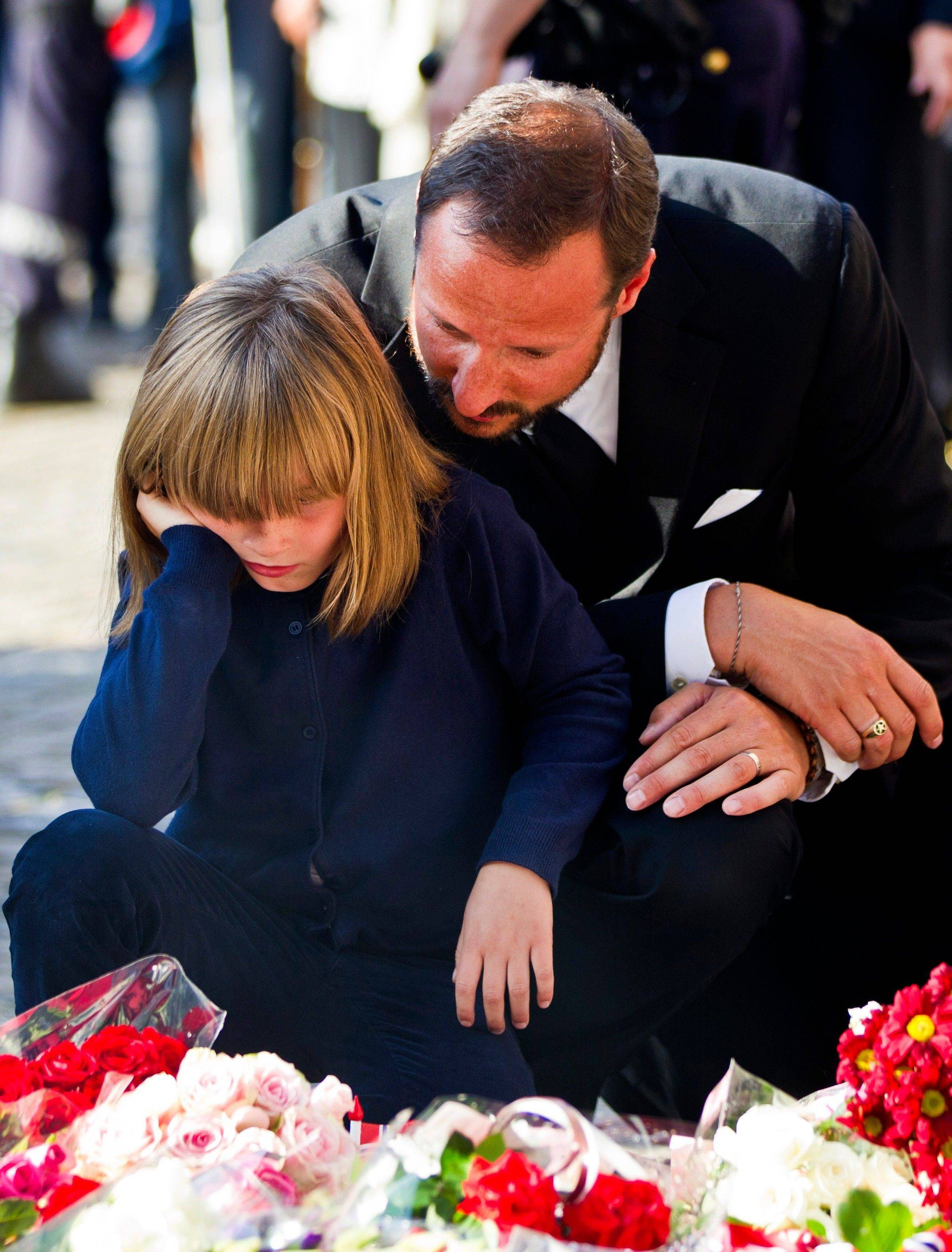 Norwegian Crown Prince Haakon, right, and Princess Ingrid Alexandra attend a vigil for victims of Friday�s attacks in Oslo and Utoya island, outside Oslo Cathedral, Saturday, July 23, 2011. A massive bombing Friday in the heart of Oslo was followed by a horrific shooting spree on an island hosting a youth retreat for the prime minister�s center-left party. The same man, a Norwegian with reported Christian fundamentalist, anti-Muslim views, was suspected in both attacks.
