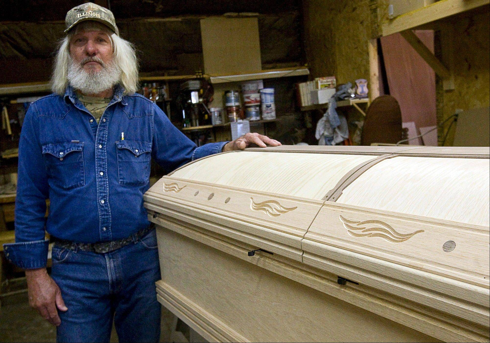 Ed Ikemire, of Findlay, Ill., is making a casket for himself in red oak with walnut trim and inlays.