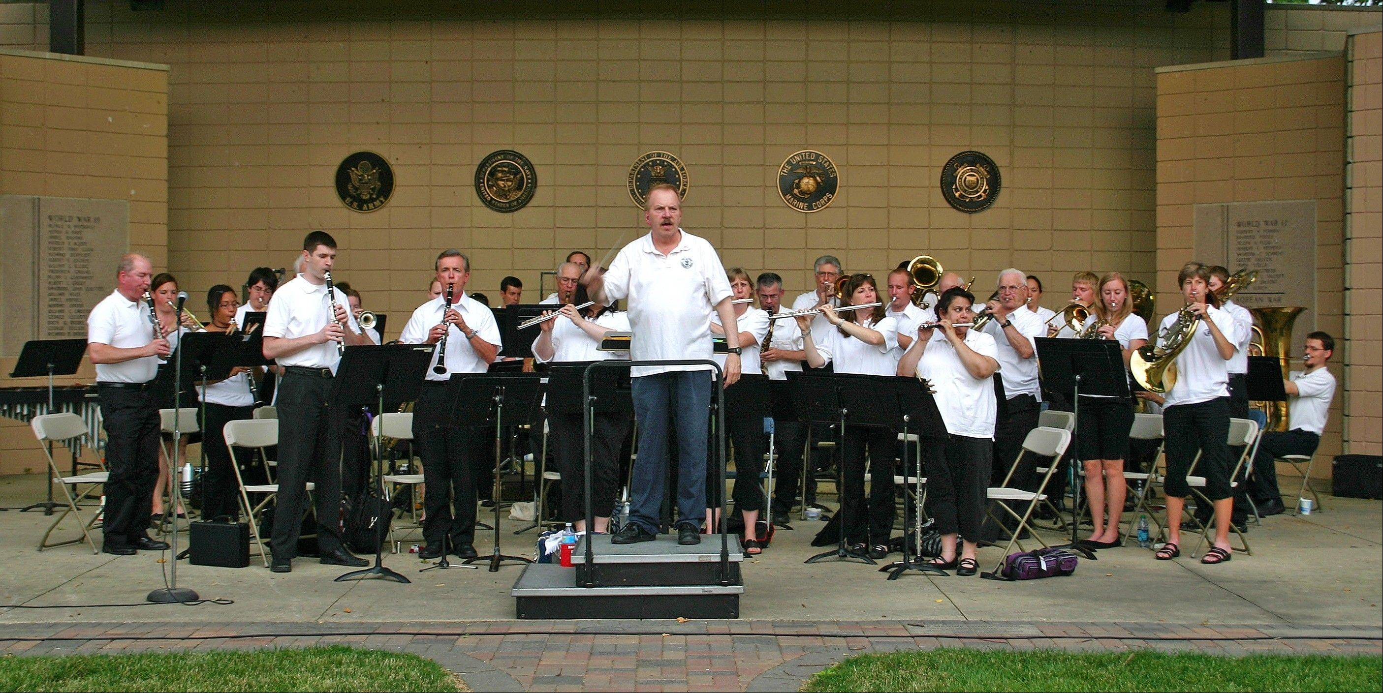 The Des Plaines Park District Community Concert Band, under the direction of Larry J. Carle, performs �The Star-Spangled Banner� June 30 at Lake Park.