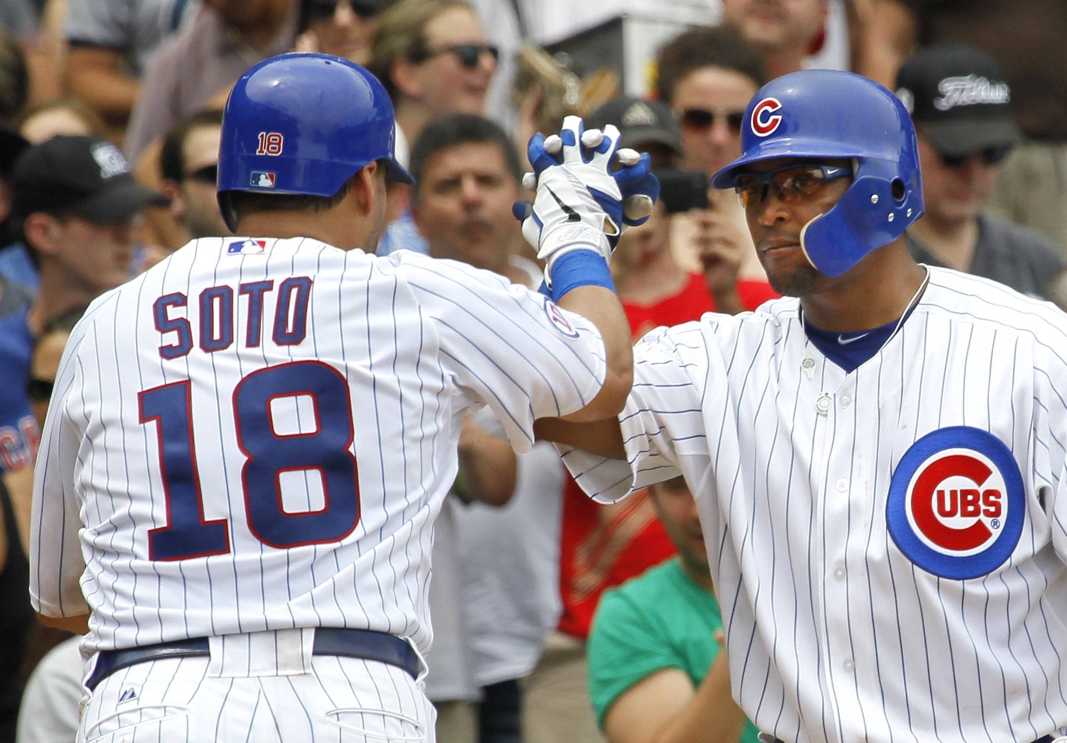 Geovany Soto, left, is greeted at home by Marlon Byrd after his home run off Houston Astros starting pitcher Wandy Rodriguez during the fifth inning Saturday at Wrigley Field.