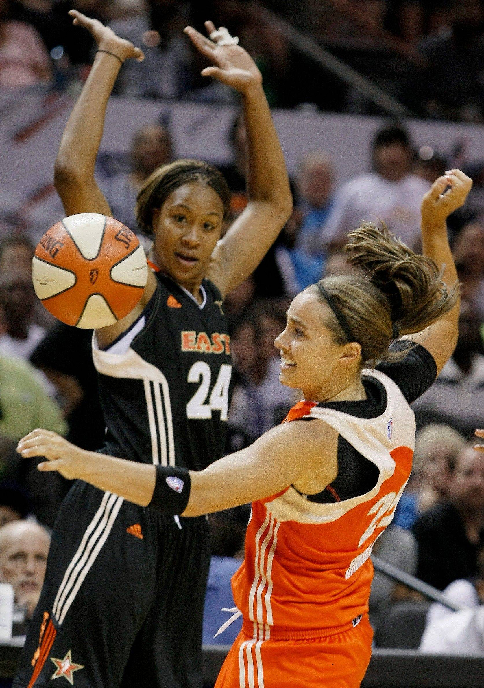 The West�s Becky Hammon, right, is blocked by the East�s Tamika Catchings during the second half of the WNBA All-Star Game. Catchings was named one of the top 15 players in the league�s history Saturday.