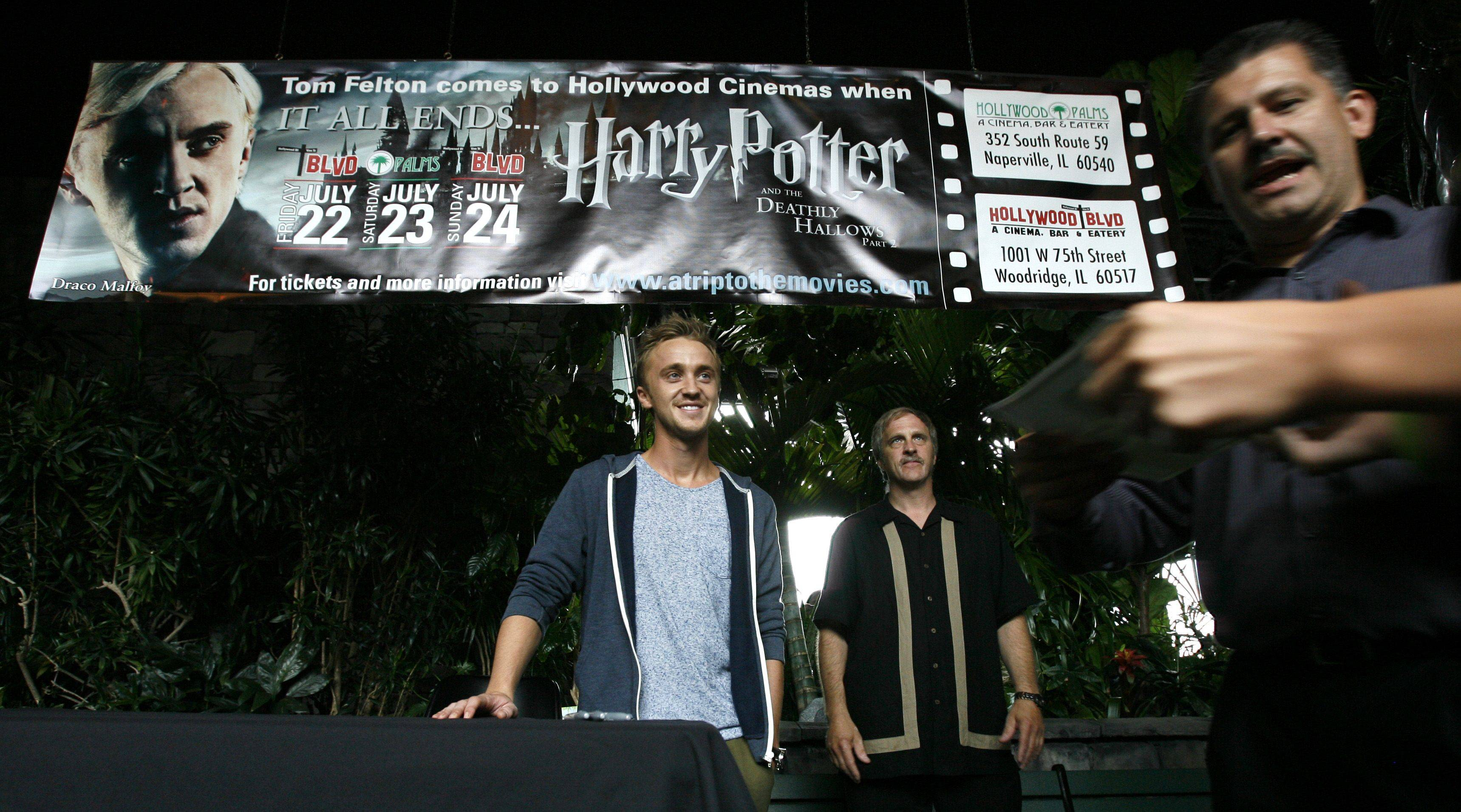 Actor Tom Felton, who plays Draco Malfoy in the Harry Potter movie series, looks toward hundreds of fans before signing autographs at the Hollywood Palms Cinema in Naperville on Saturday.
