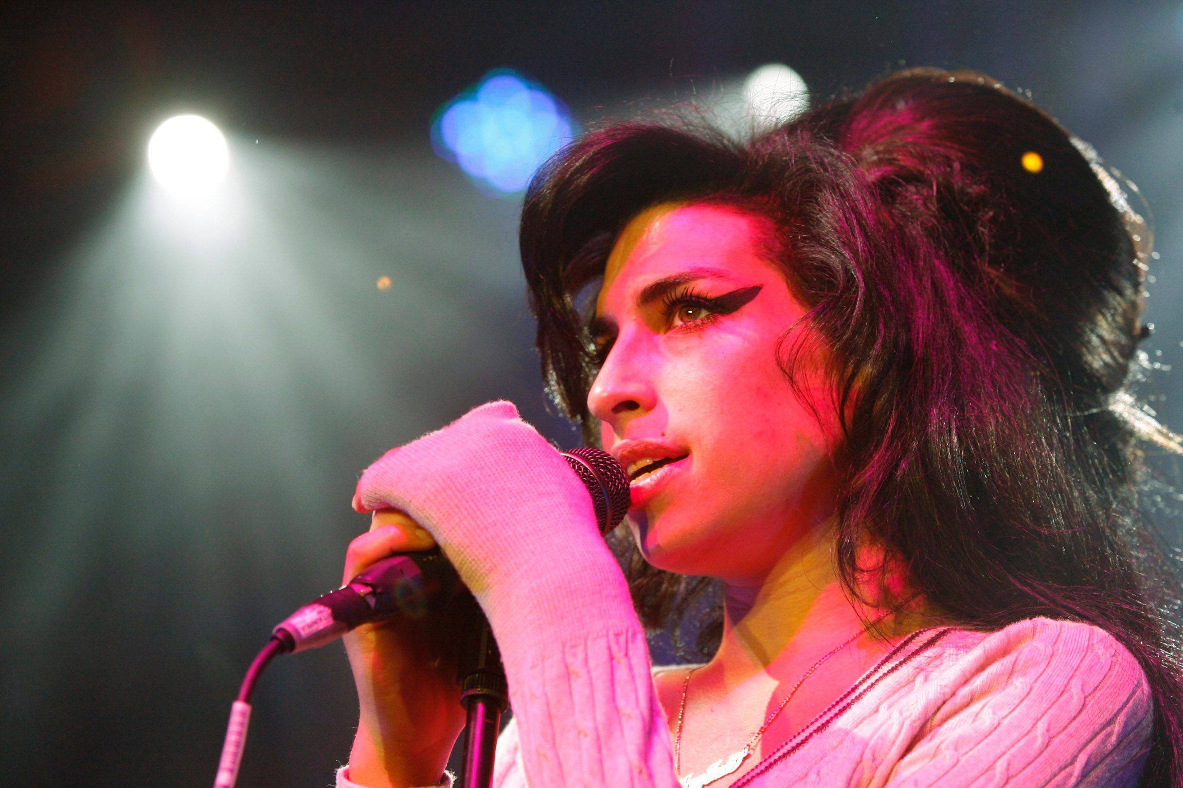 British singer Amy Winehouse performs during a concert at the Volkshaus in Zurich, Switzerland in 2007. Amy Winehouse, the beehived soul-jazz diva whose self-destructive habits overshadowed a distinctive musical talent, was found dead Saturday in her London home, police said. She was 27.