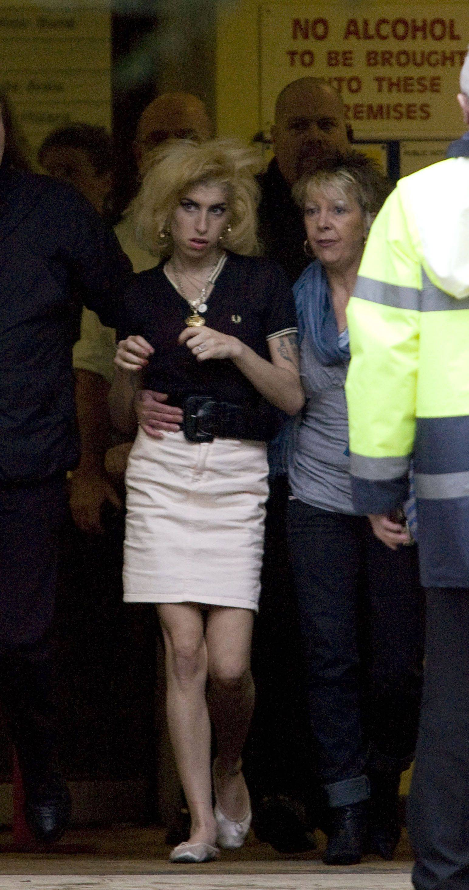 Amy Winehouse, left, leaves Snaresbrook Crown Court in London with an unidentified woman after the hearing of her husband Blake Fielder-Civil in 2008. Fielder-Civil was in court charged with grievous bodily harm and preventing the course of justice.