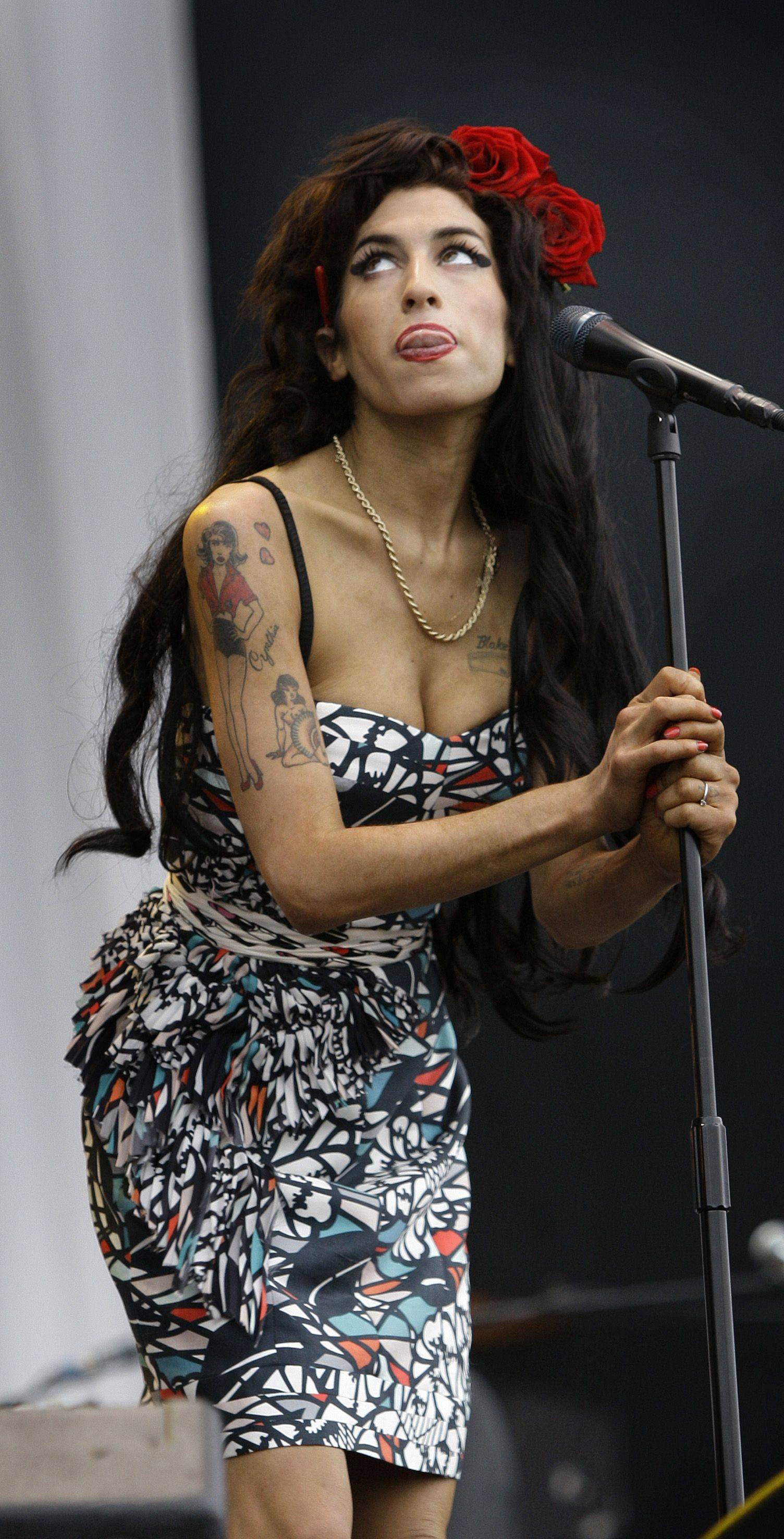Amy Winehouse performs at the V Festival, near Chelmsford, England.