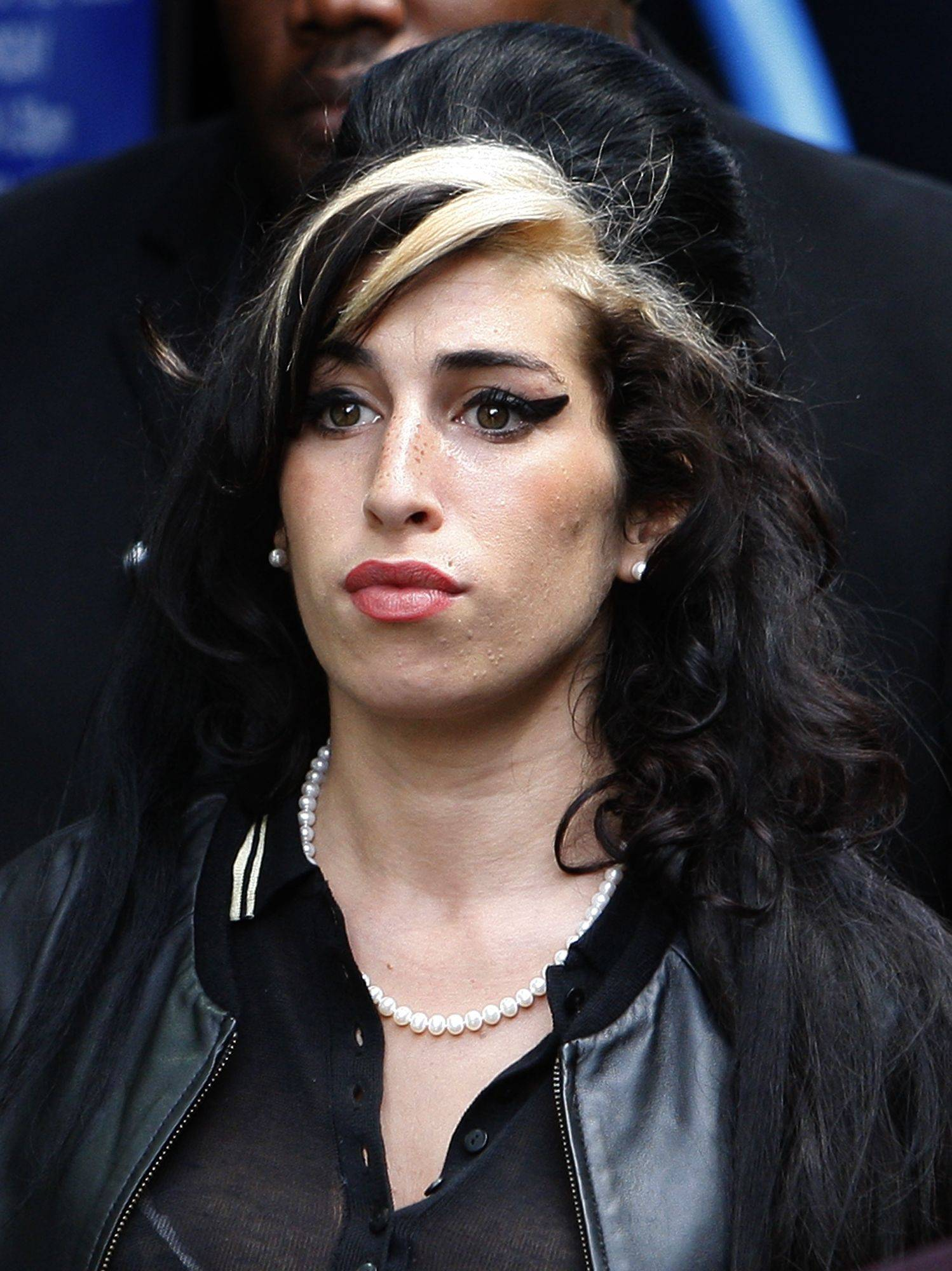 Amy Winehouse leaves Westminster magistrates court in London where a judge acquitted her of assaulting a fan who asked to take her picture. District Judge Timothy Workman found the 25-year-old singer not guilty of punching dancer Sherene Flash in the eye after the fan asked to take her picture following a charity ball in September.
