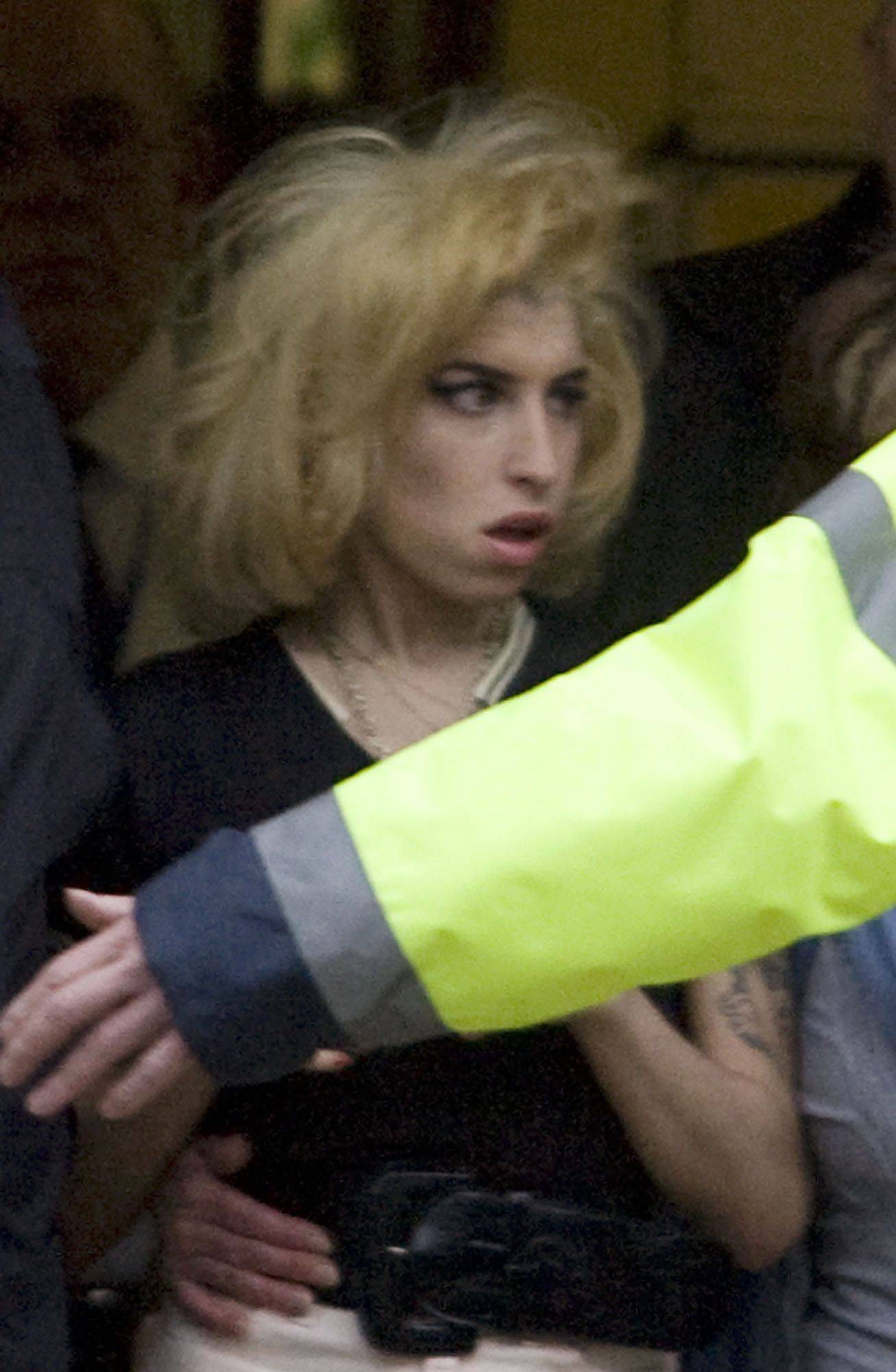 Amy Winehouse leaves Snaresbrook Crown Court in London after the hearing of her husband Blake Fielder-Civil. Fielder-Civil wast charged with grievous bodily harm and preventing the course of justice.