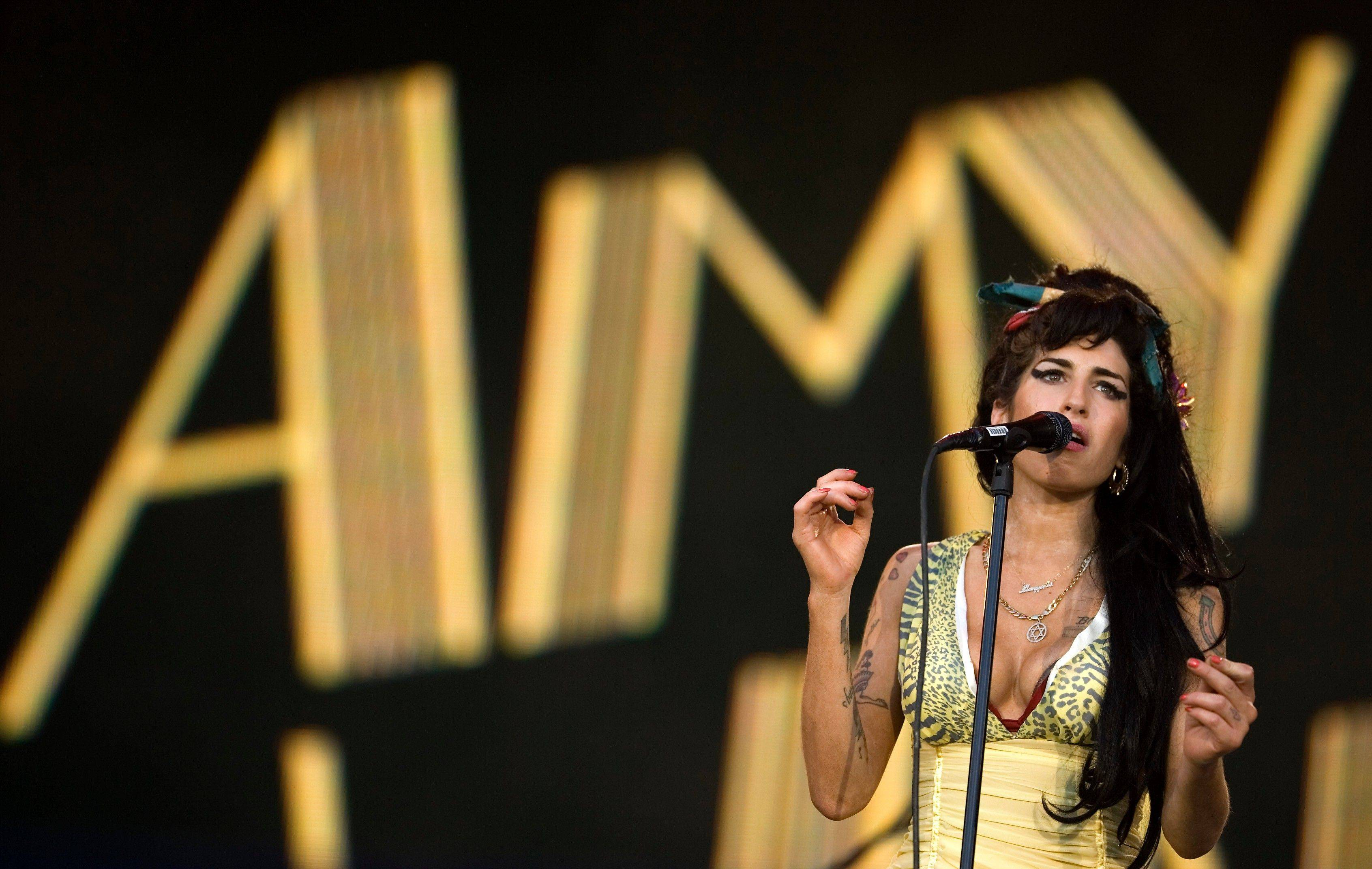 Amy Winehouse of England performs during the Rock in Rio music festival in Arganda del Rey, on the outskirts of Madrid.