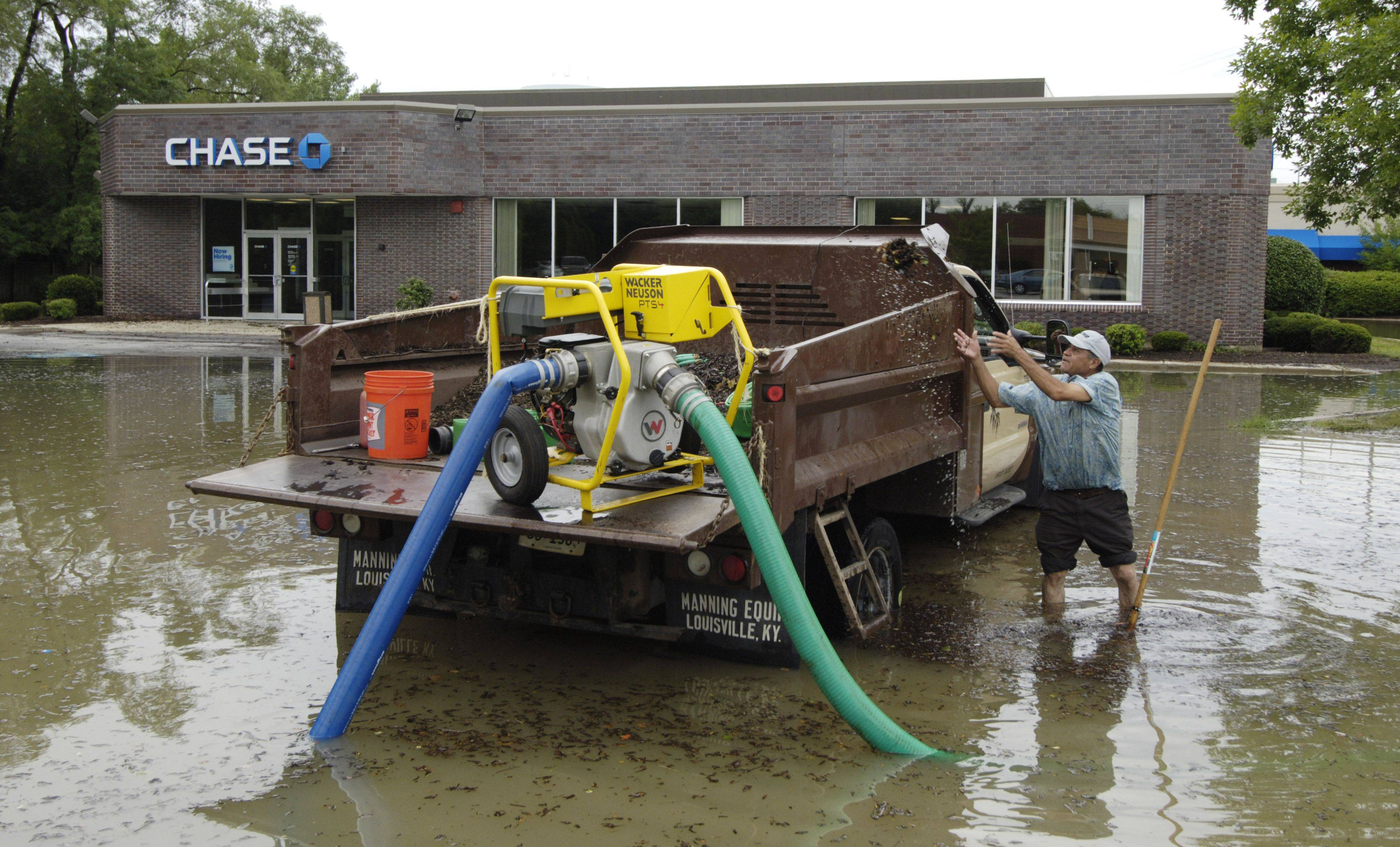 Attractive While Pumping Out Water, Roberto Rodriguez Of Brickman Landscaping Attempts  To Clear The Sewer Cover