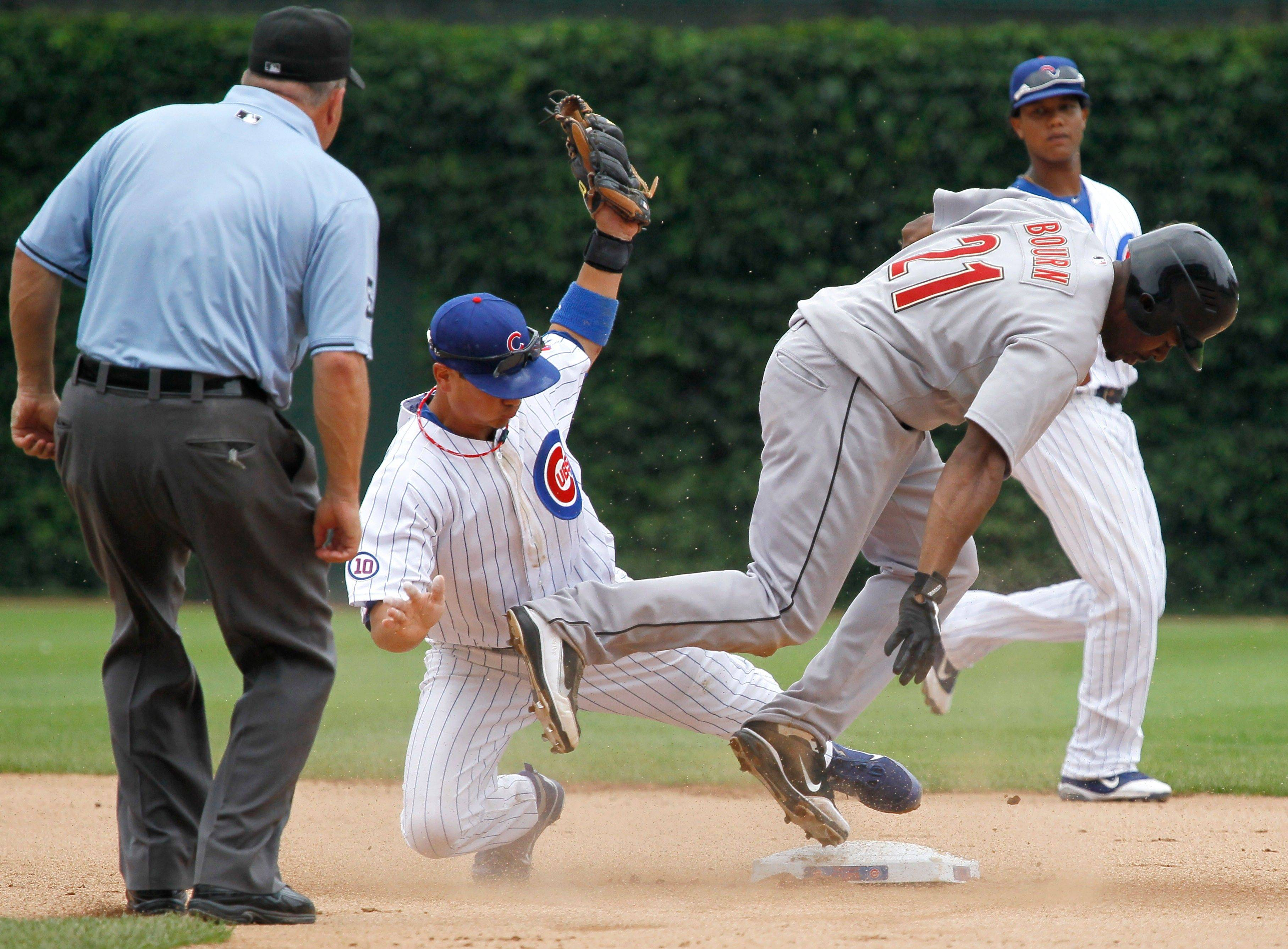 Houston Astros' Michael Bourn, right, is caught stealing second by Cubs second baseman Darwin Barney during the fifth inning of a baseball game Saturday.