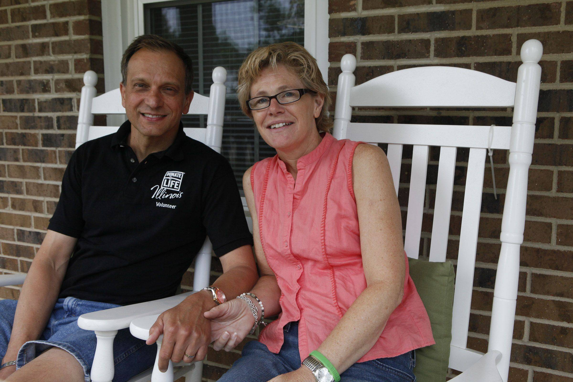 Rick Majewski/rmajewski@dailyherald.com Kevin Lue's and his wife Maureen Lue's on their front porch in Bartlett. They met through their passion for running, which both of them still do even after Kevin's heart transplant surgery two years ago.  Friday July 1, 2011