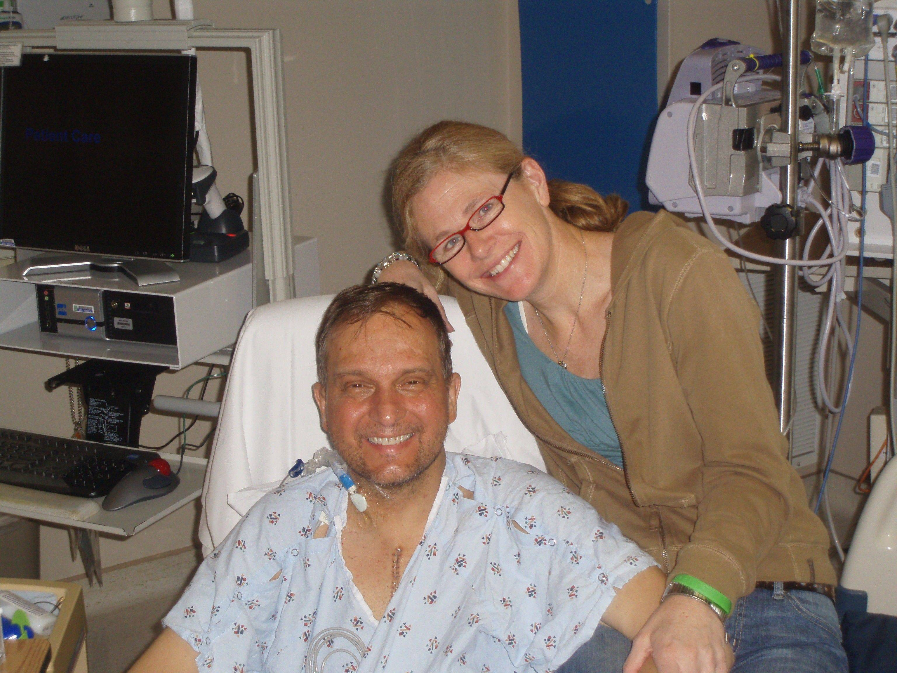 Bartlett's Kevin Lue recovers the day after his heart tranplant with the support of his wife, Maureen. The couple found out a heart was available the day after their wedding.