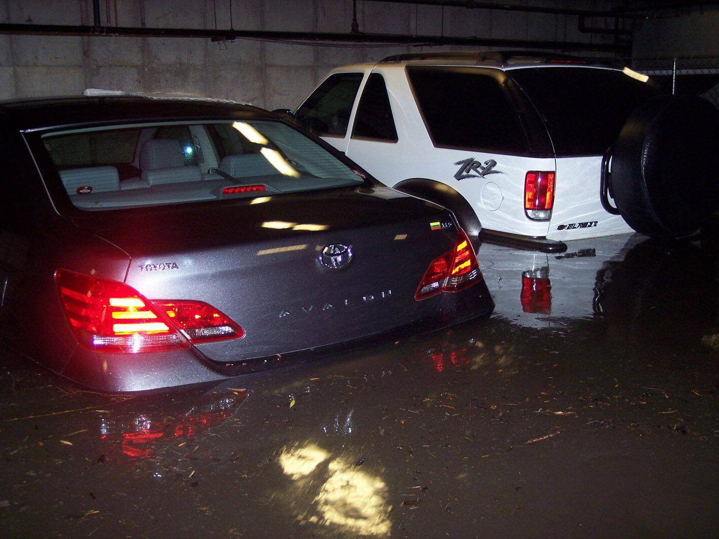 Eric Kinkel of Palatine took this picture of his white SUV and another car submerged in water in the garage of his condo building. Forty plus cars were damaged by the 3 to 4 feet of water, according to Kinkel.