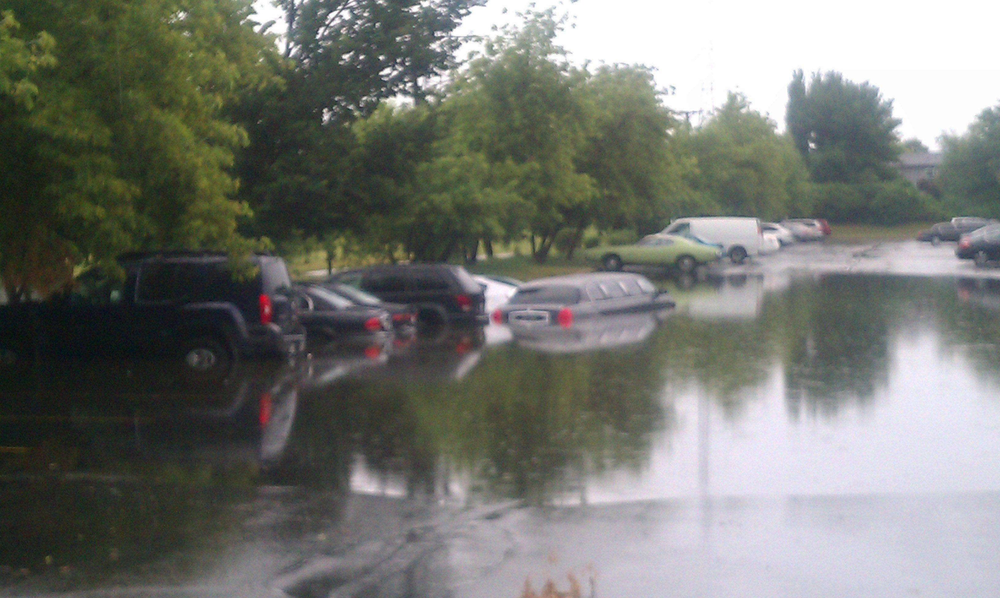 Cars and a limo are submerged in a condo parking lot in Wheeling.