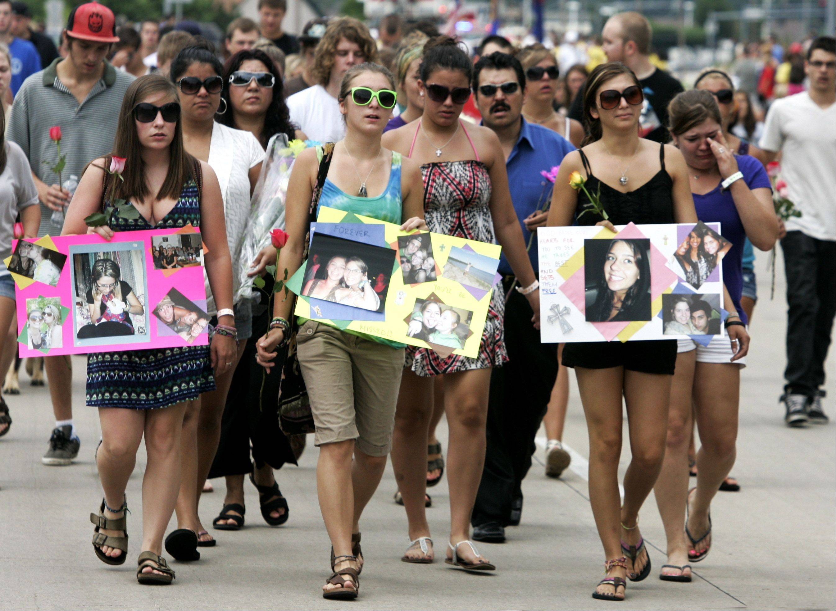 Friends and family of hit-and-run victim Gabriella Drozdz march in the Lake Zurich Alpine Festival parade in her memory Sunday. Drozdz, of Lake Zurich, was killed by someone driving an SUV Friday night as she and two other friends were walking along Church Street on their way to Alpine Fest.