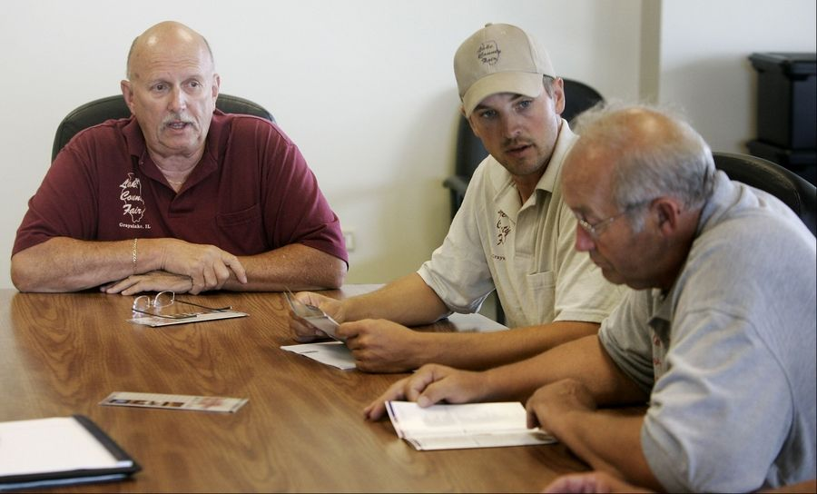 Lake County Fair Association Vice President Jerry Pretzman, left, President Mike Richards, and Treasurer Pete Tekampe discuss the 2011 Lake County Fair, which begins Tuesday.