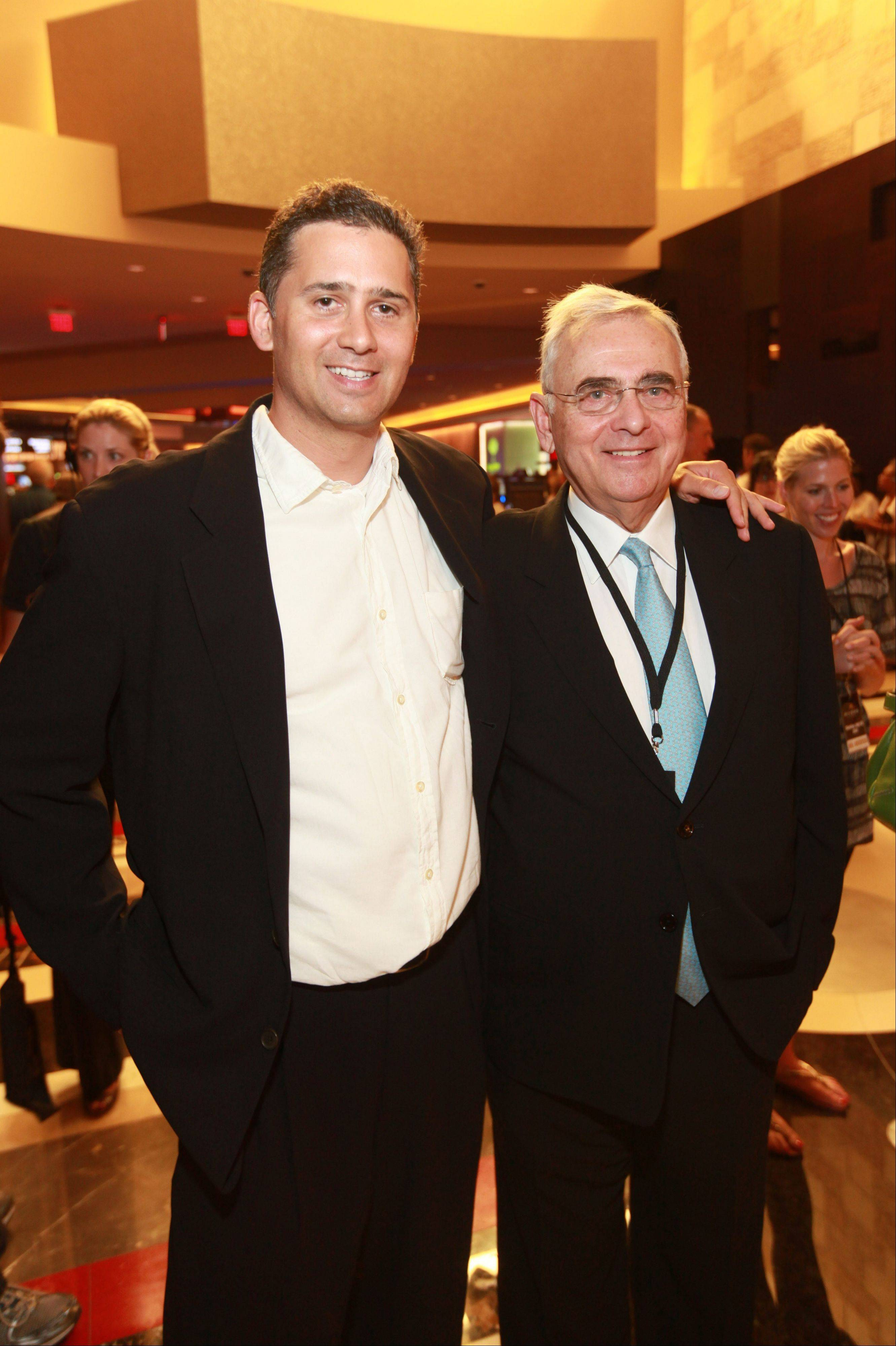 Andy Bluhm, left, enjoys opening festivities at Des Plaines' new Rivers Casino with his father, Neil Bluhm, chairman of Midwest Gaming & Entertainment.