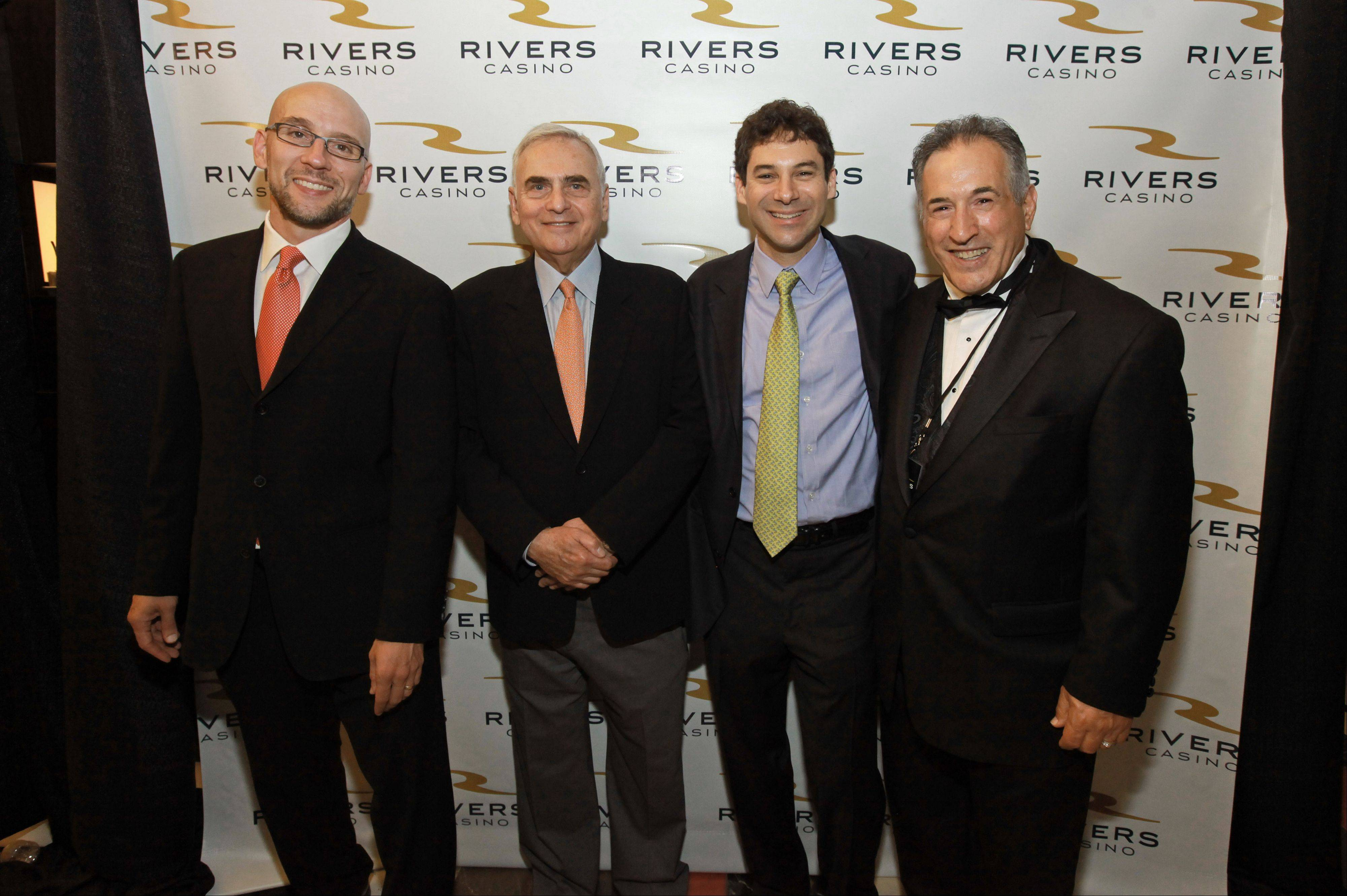 Neil Bluhm, second from left, chairman of Midwest Gaming & Entertainment, celebrates last week's opening of Rivers Casino with David Patent, far left, chief operating officer of Rush Street Gaming LLC; Greg Carlin, chief executive officer of Midwest Gaming & Entertainment; and Des Plaines Mayor Martin J. Moylan, right.