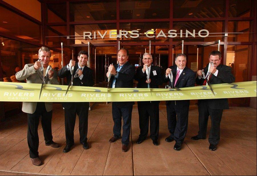 Cutting the ribbon to the new Rivers Casino in Des Plaines are, from left, Jeff Parr, co-CEO of Clairvest; Greg Carlin, CEO of Midwest Gaming & Entertainment LLC; actor Jim Belushi; Neil Bluhm, chairman of Midwest Gaming & Entertainment; Des Plaines Mayor Martin J. Moylan; and Bill Keena, general manager of Rivers Casino.