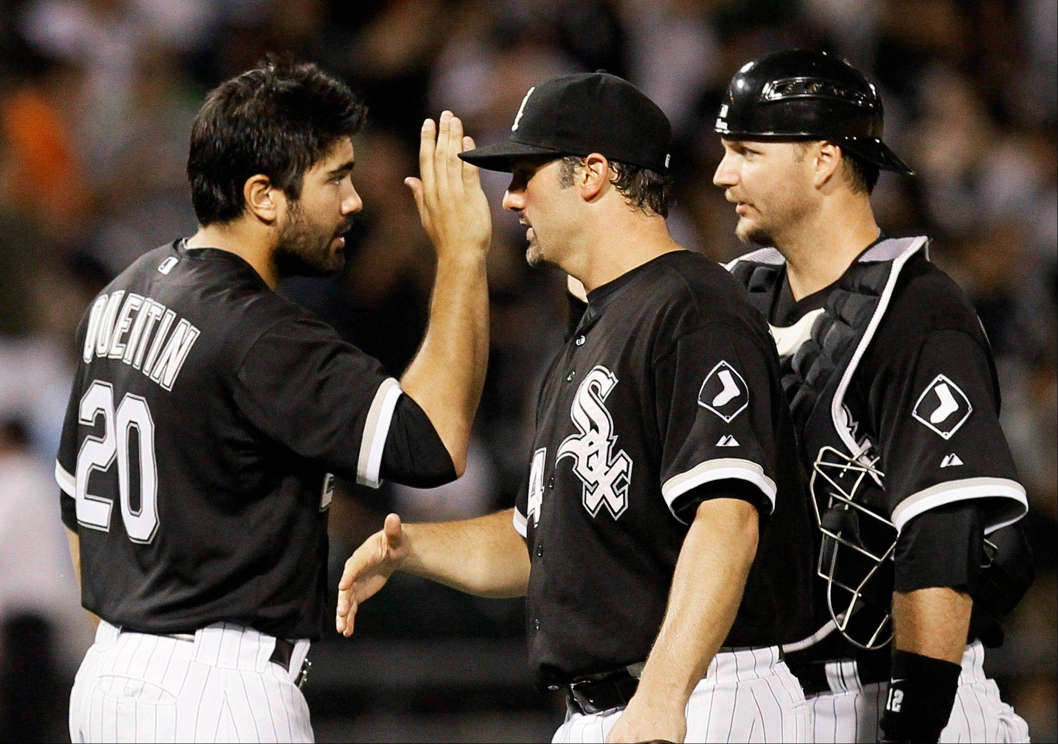 Sox outfielder Carlos Quentin, left, celebrates Monday with Paul Konerko, center, and A.J. Pierzynski after Chicago's 6-3 win over the Detroit Tigers.