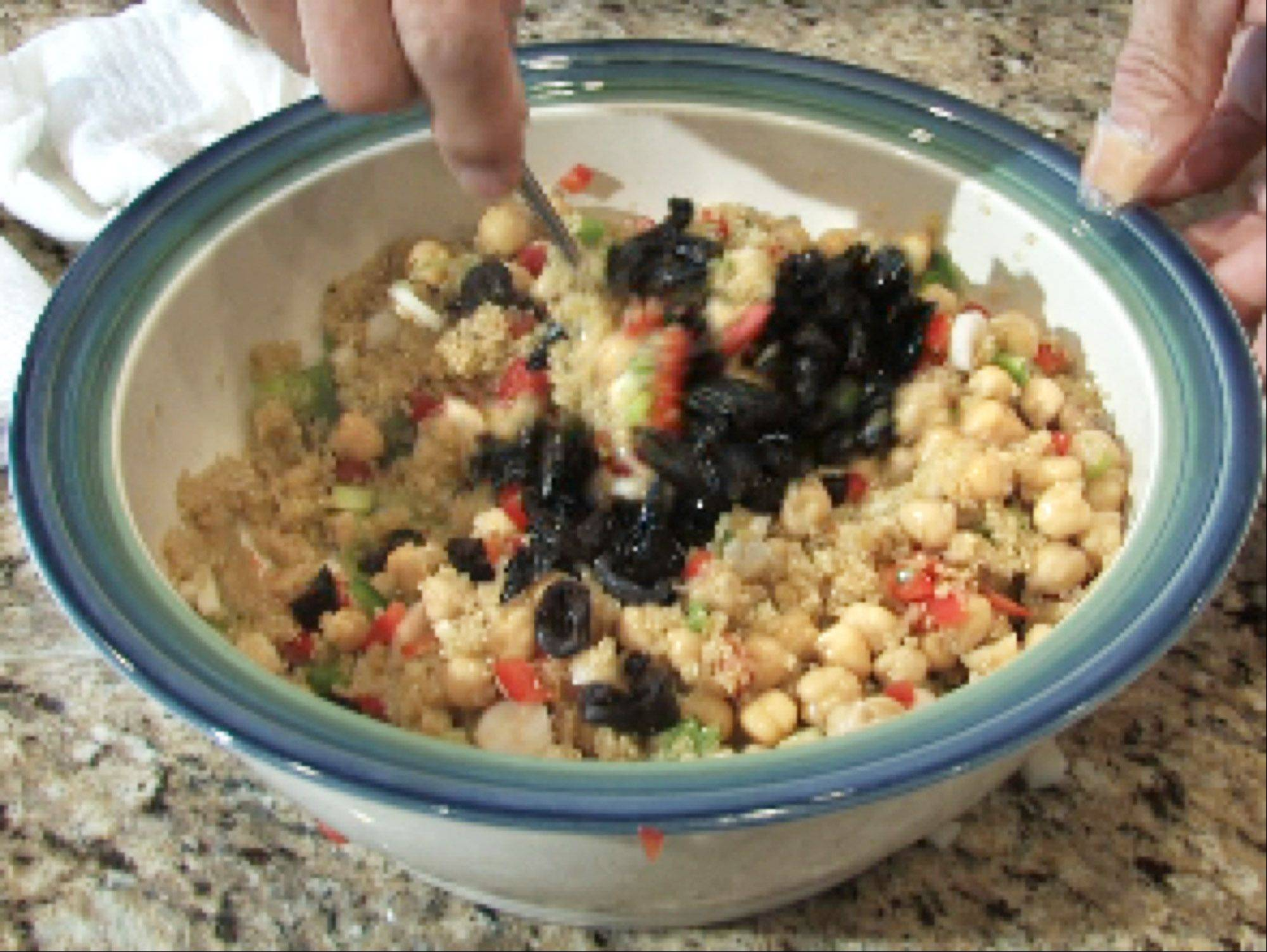 John Starks/jstarks@dailyherald.com Cook of the Week Dan Bressler of South Elgin adds black, oil-cured olives to quinoa salad.