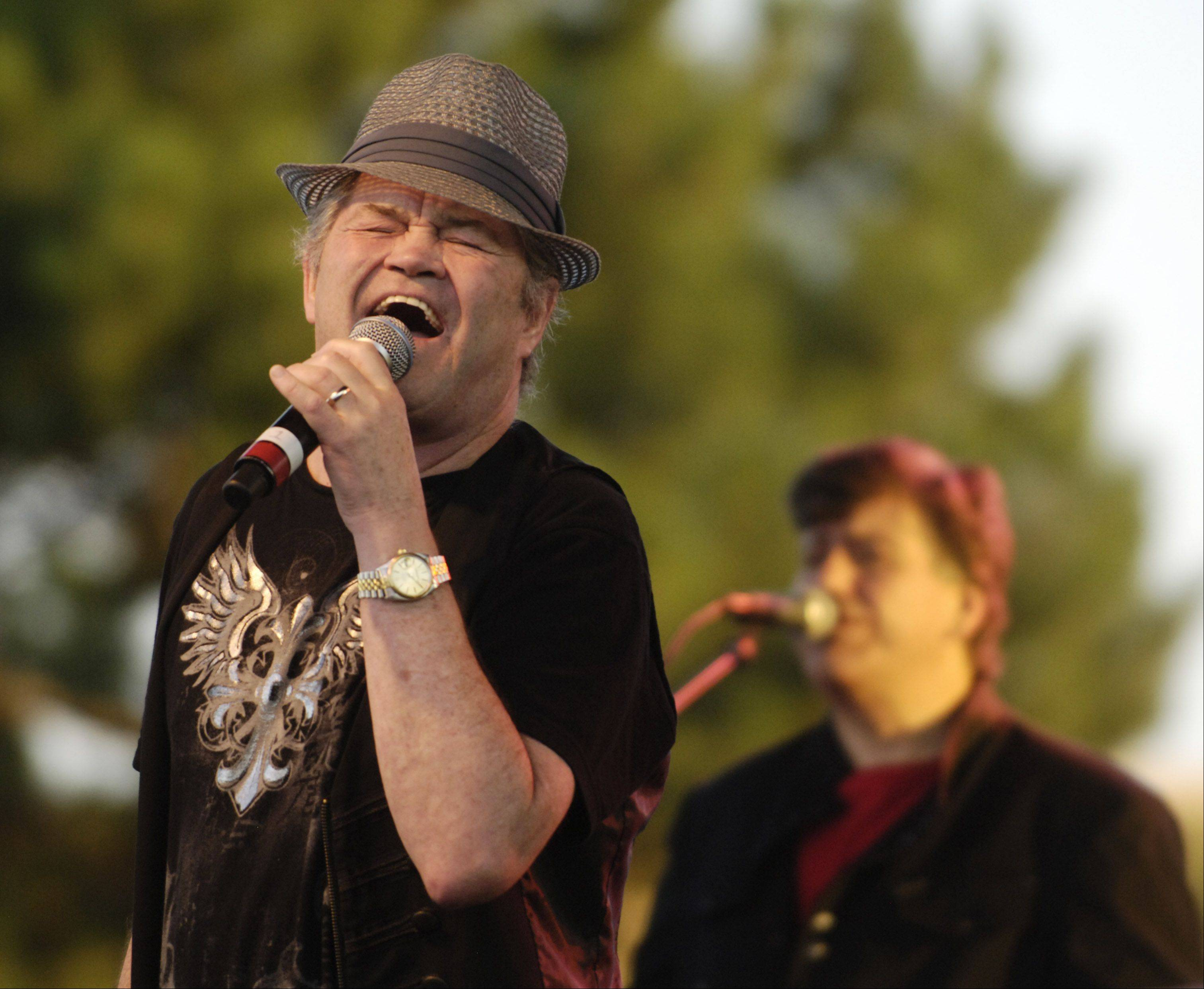 Micky Dolenz of The Monkees performs Tuesday evening as part of the summer concert series on the Elk Grove Village Green.