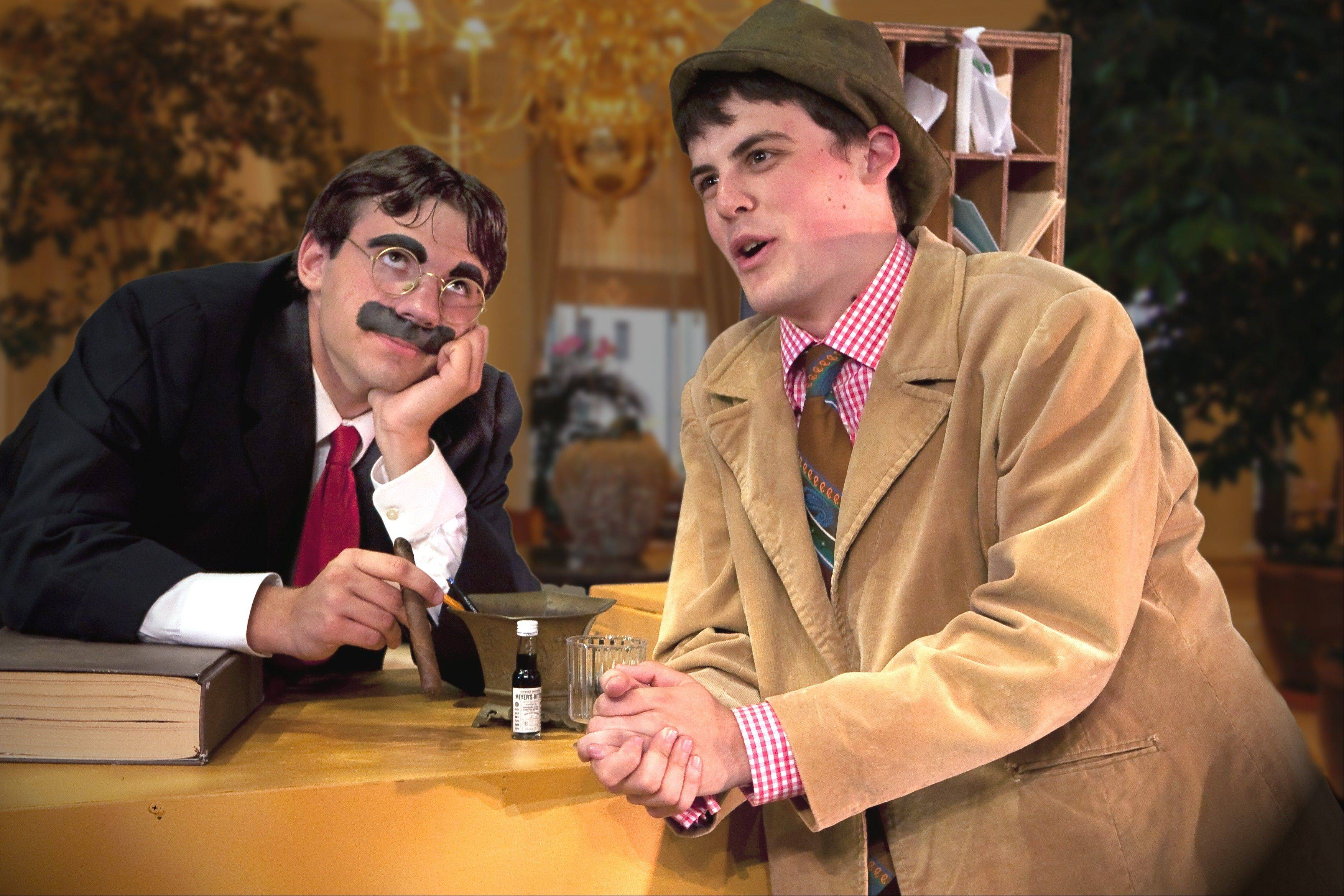 "Jake Robertson plays Groucho and Carlos Kmet is Chico in a scene from ""The Cocoanuts"" at the Schaumburg Prairie Center for the Arts."