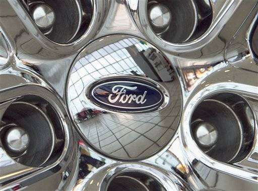 A Ford logo on a wheel at a car dealership in Omaha, Neb.
