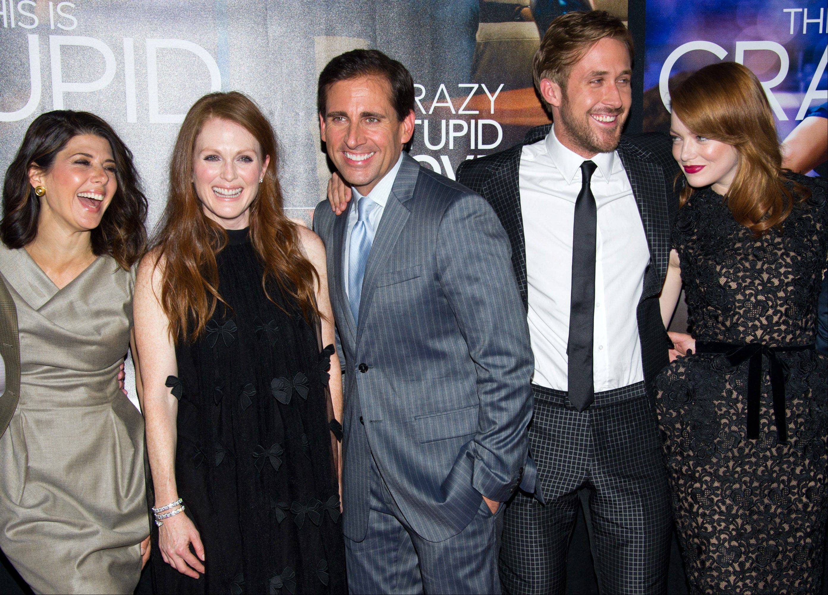 "The first glimpse of Steve Carell's post-""Office"" days is ""Crazy Stupid Love,"" an ensemble romantic comedy in which he stars and that he produced. Marisa Tomei, left, Julianne Moore, Steve Carell, Ryan Gosling and Emma Stone arrive at the premiere of the movie in New York last Tuesday."