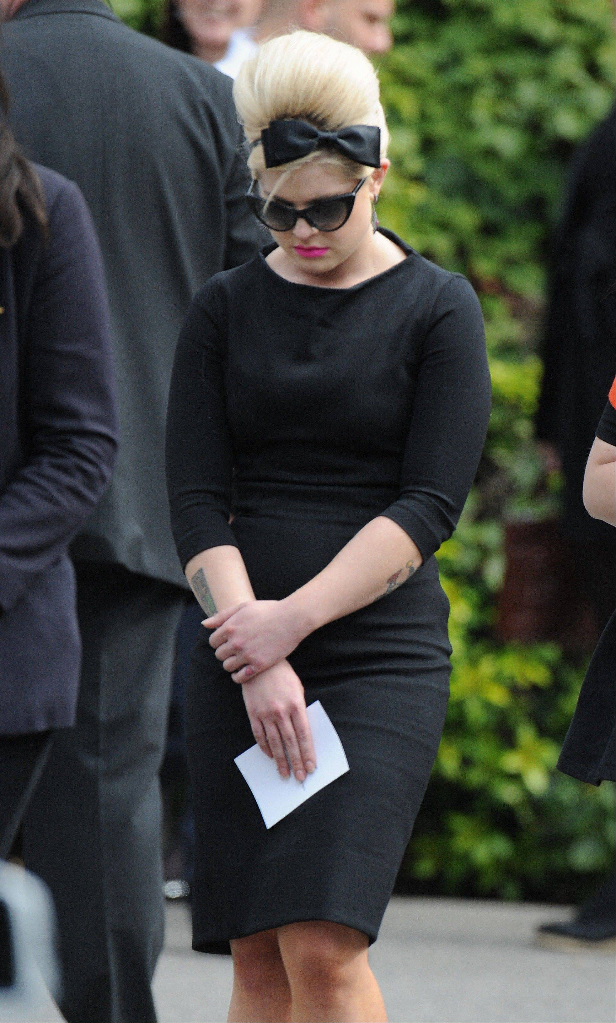 Media personality Kelly Osbourne leaves Golders Green Crematorium in London, Tuesday, July 26, 2011, after attending the funeral of singer Amy Winehouse.