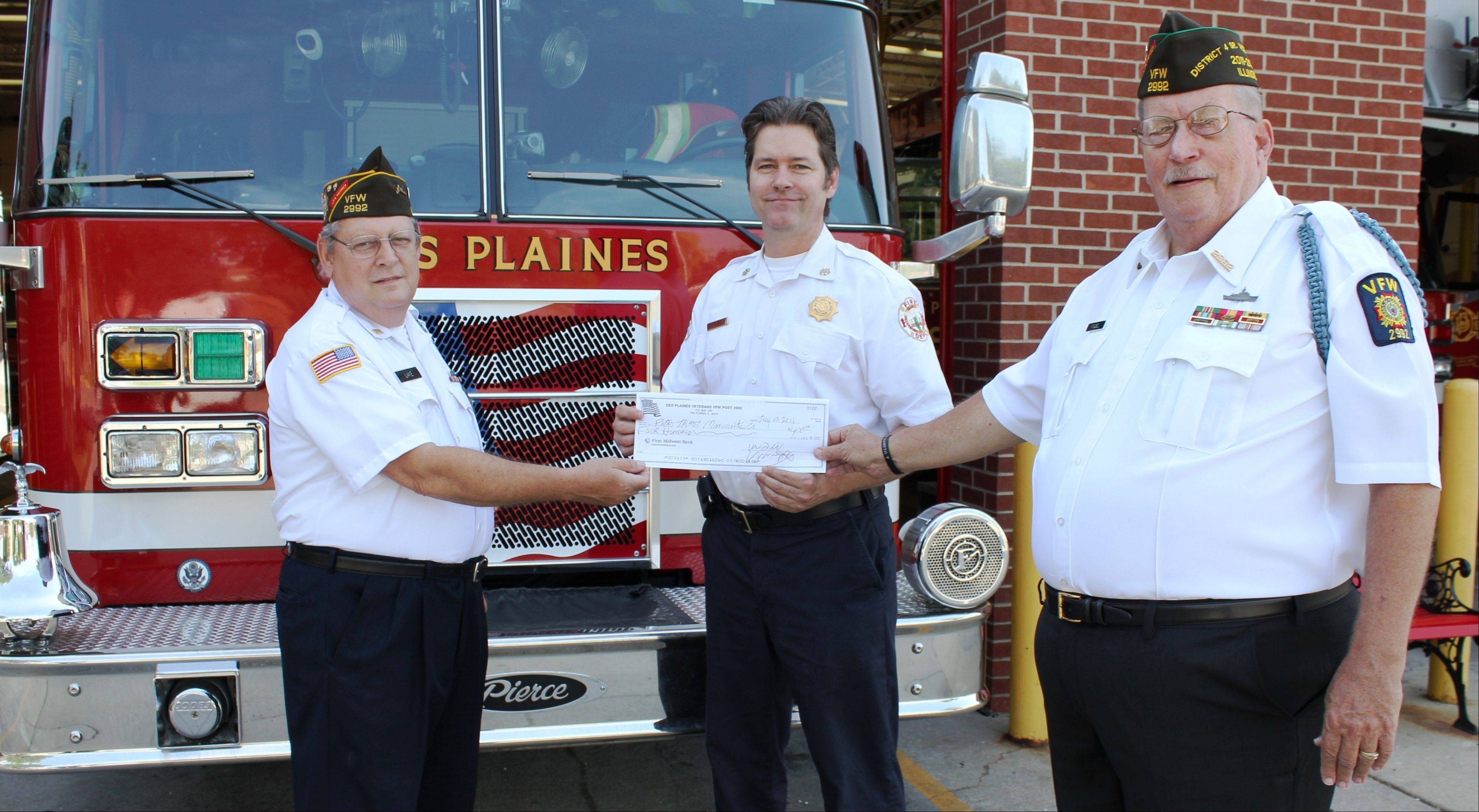 Pictured, from left, Des Plaines VFW Post 2992 special projects Officer Mike Lake, Deputy Fire Chief Ron Eilken and VFW Commander William Fiegel pose for a photograph as the VFW Post presents a check for $400 to the Des Plaines Fire Department. According to Deputy Chief Eilken, the fire department hopes to have the 9/11 Memorial in place for this year's Sept. 11, 2011, ceremony at city hall.