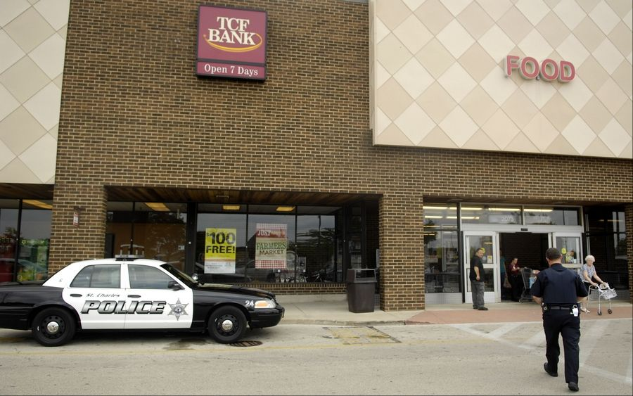 St. Charles police investigate a robbery Tuesday at the TCF National Bank inside the Jewel-Osco store near Randall Road and Prairie Street in St. Charles.