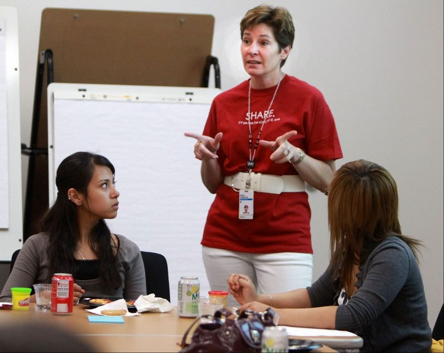 Maria Thompson, director of innovation strategy with Motorola, talks to students at Harper College in a program to bolster first-year student success at the college in Palatine.