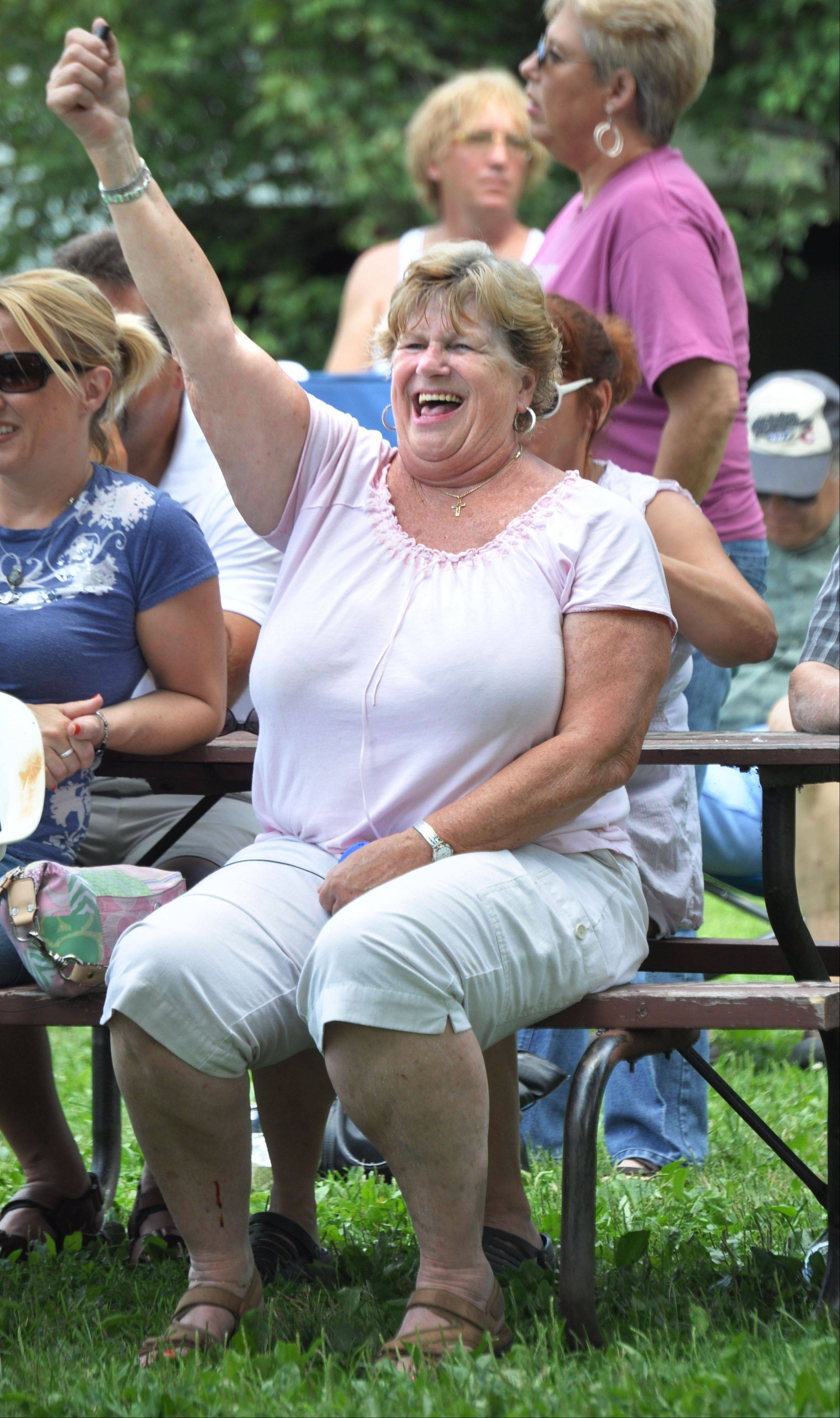 Kathy Bodnar from West Chicago sings along to the band Jordan at the second annual Anonapalooza Family Summerfest in Geneva last year.