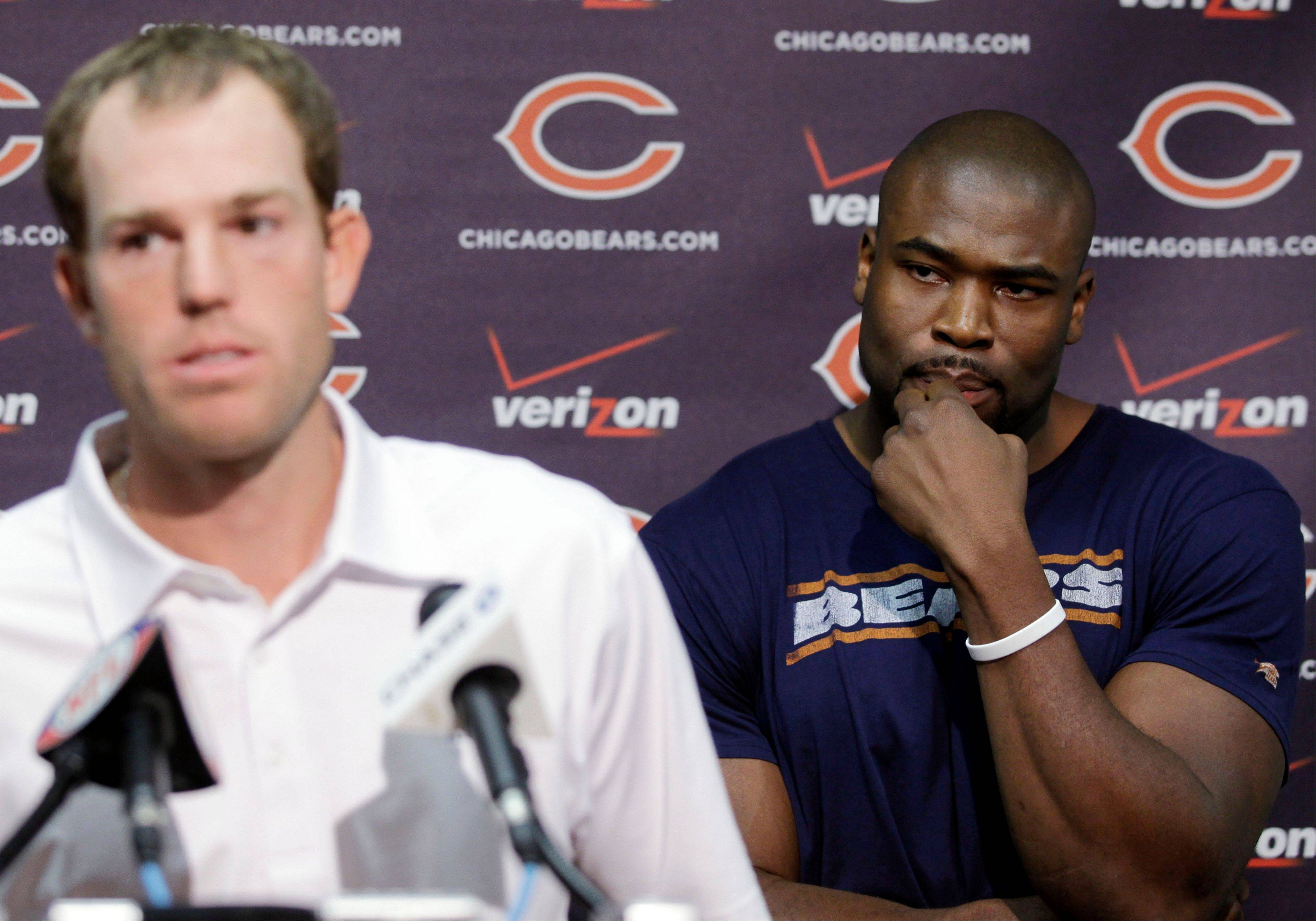 Bears defensive lineman Israel Idonije, right, listens to Robbie Gould speaks at a news conference at Halas Hall in Lake Forest on Tuesday. Both players insist there won't be any issues with teammates reporting to camp out of shape.