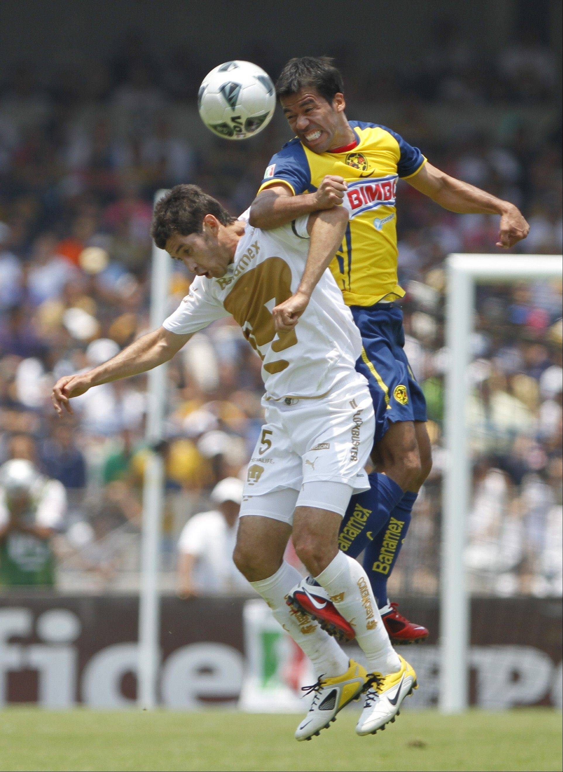 Club America's Pavel Pardo, top, and Pumas' Israel Castro battle during a Mexican soccer league game in Mexico City, last May. The 25-year-old Pardo has signed to play for the Chicago Fire.