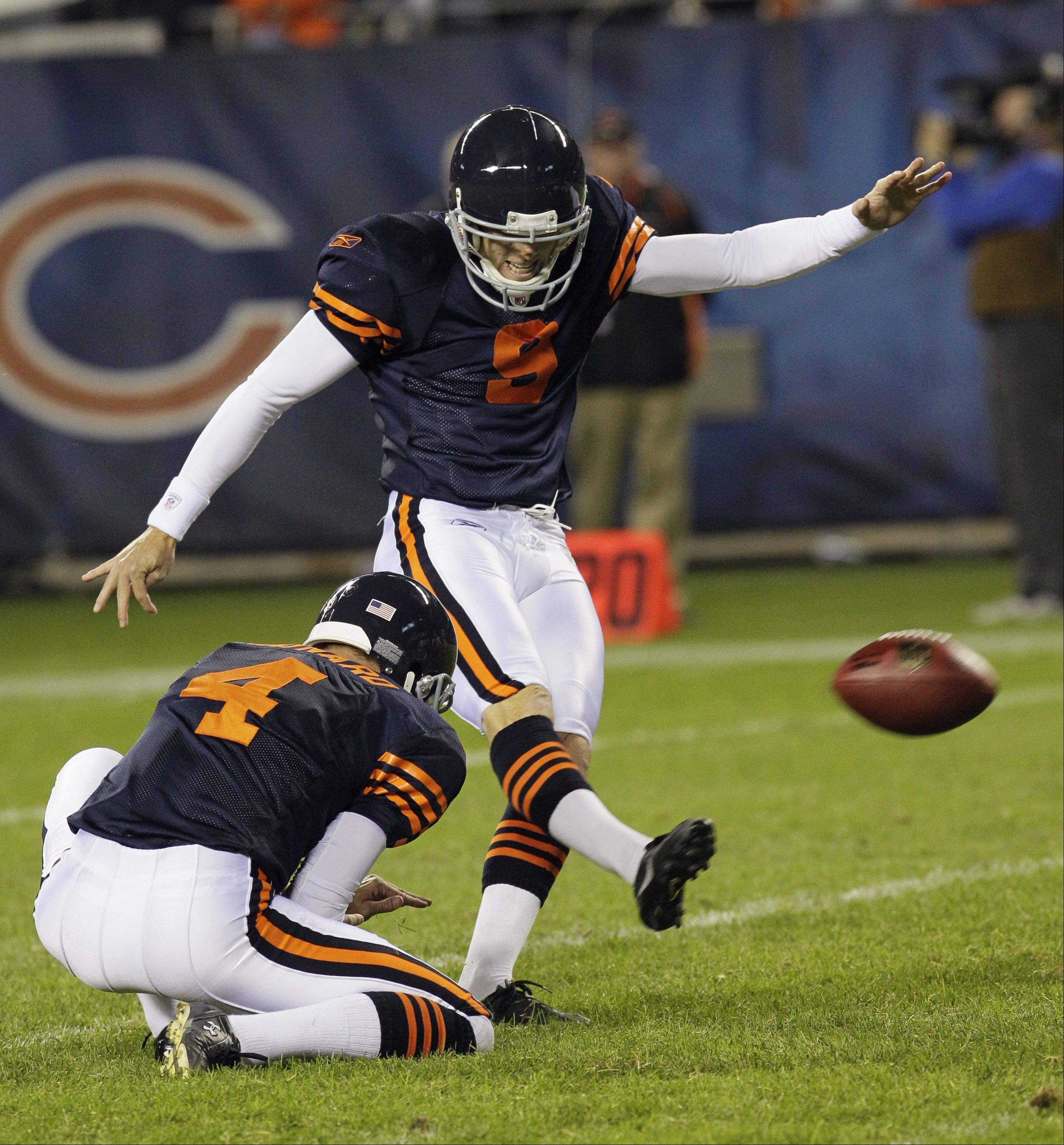 Robbie Gould kicks a field goal with seconds left to give the Bears a 20-17 win over the Green Bay Packers on Sept. 27, 2010, in Chicago. Gould's holder, 37-year-old Brad Maynard, will not be back with the Bears this season.