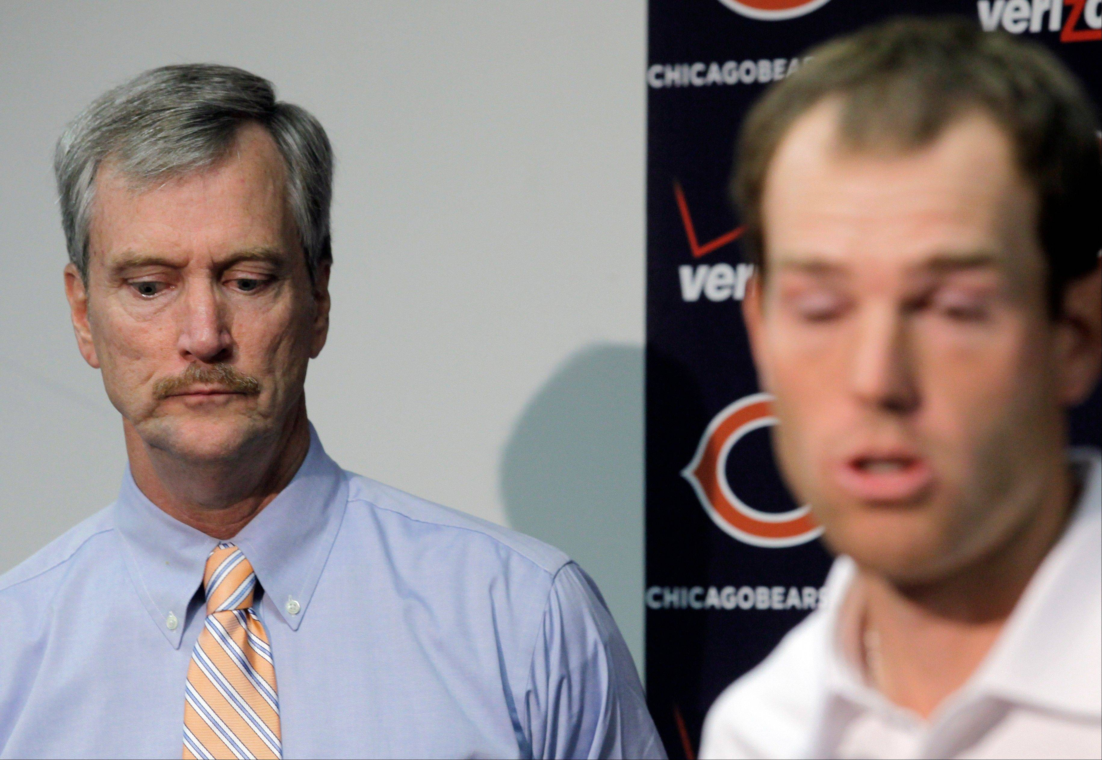 Bears chairman George McCaskey, left, listens to kicker and union representative Robbie Gould speak at a news conference at Halas Hall on Tuesday.