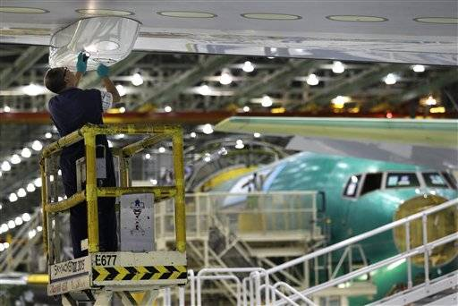 A Boeing Co. worker works on the 767 assembly line, in Everett, Wash. Businesses cut back on orders for aircraft, autos, heavy machinery and computers in June, sending demand for long-lasting manufactured goods lower for the second month in the past three.