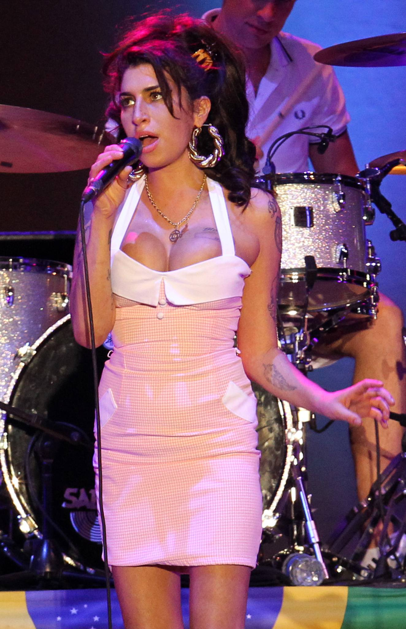British singer Amy Winehouse, shown performing in Brazil in January, is back on the Billboard charts following her death.
