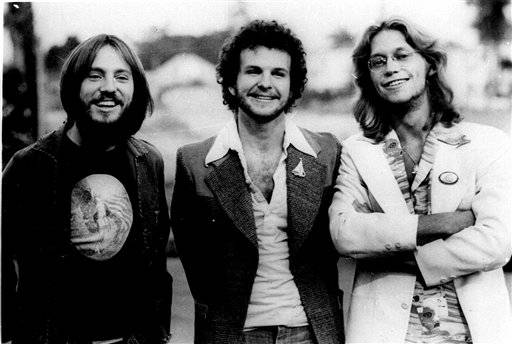 The rock group America is shown in this photo dated 1976. Members of the group, from left are: Dewey Bunnel, Dan Peek, and Gerry Beckley. Peek died Sunday in bed in his home in Farmington, Mo.