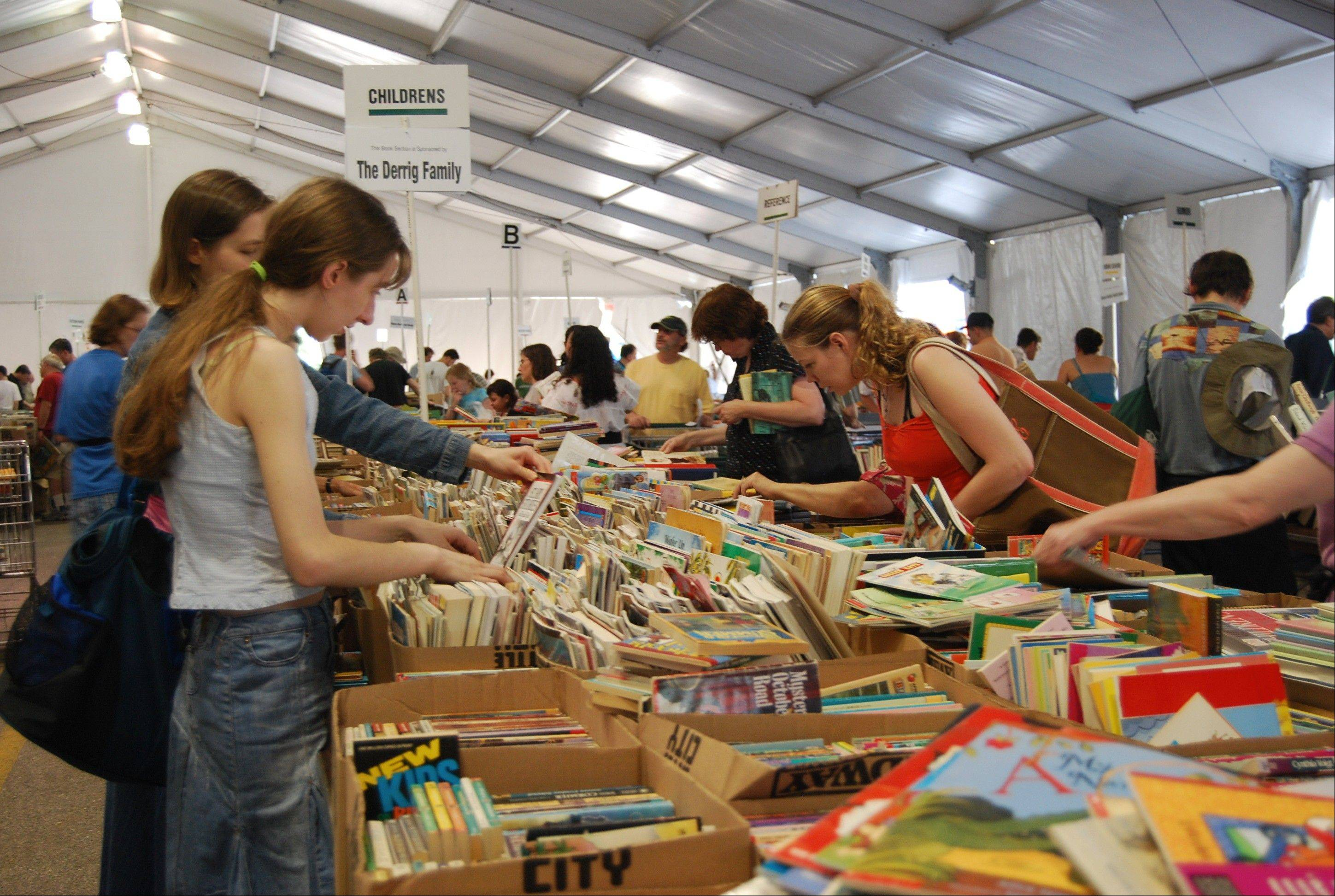Patrons browse thousands of books at last year�s Little City Book Fair, which is being relocated from Skokie to Harper College in Palatine.