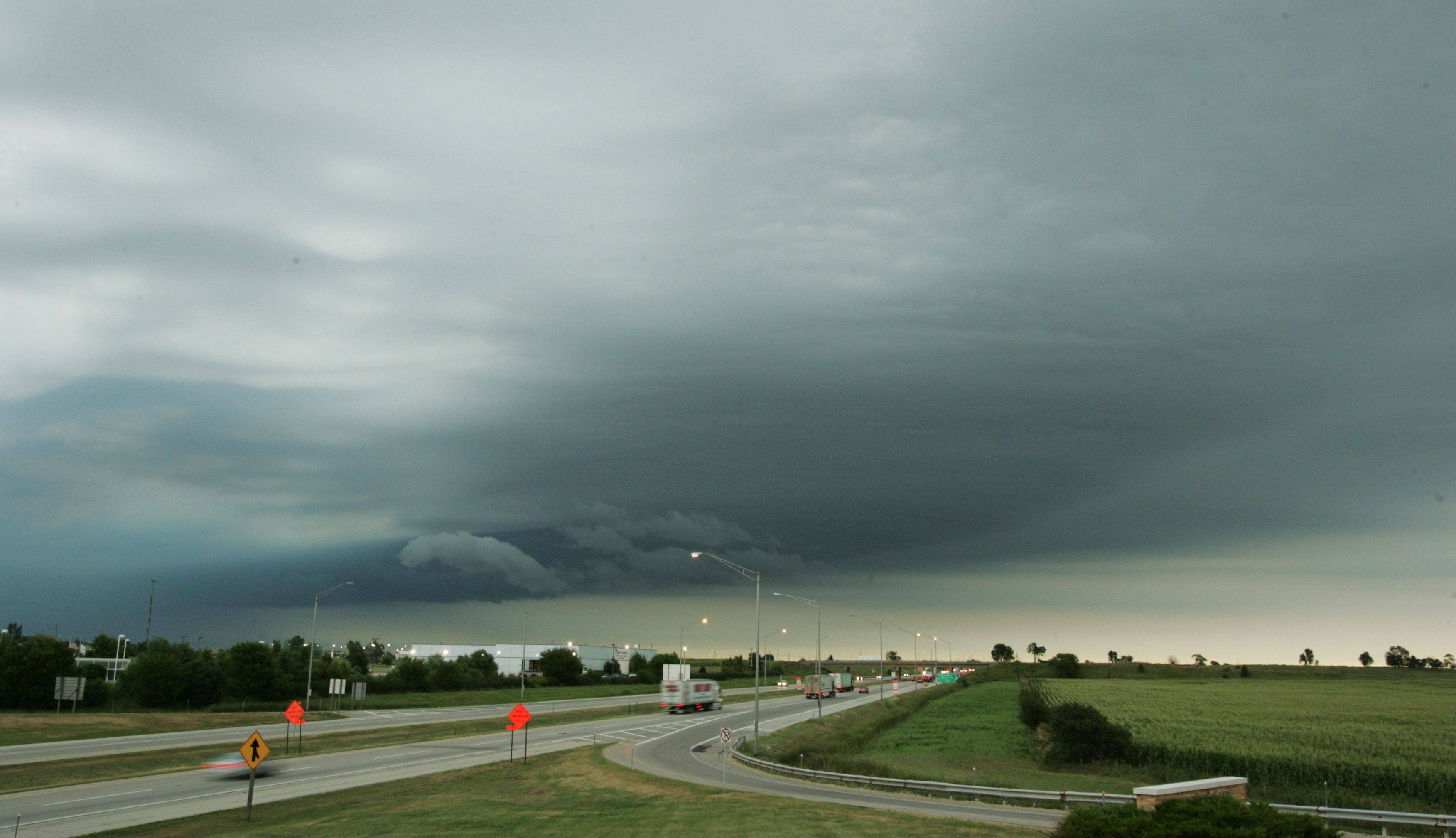A thunderstorm rolls across Boone County Wednesday morning after passing through the Rockford area. The storm was tracking toward McHenry County and northern Lake County producing heavy rains and lightning, but lacking the high winds that have wreaked havoc during previous storms this summer.