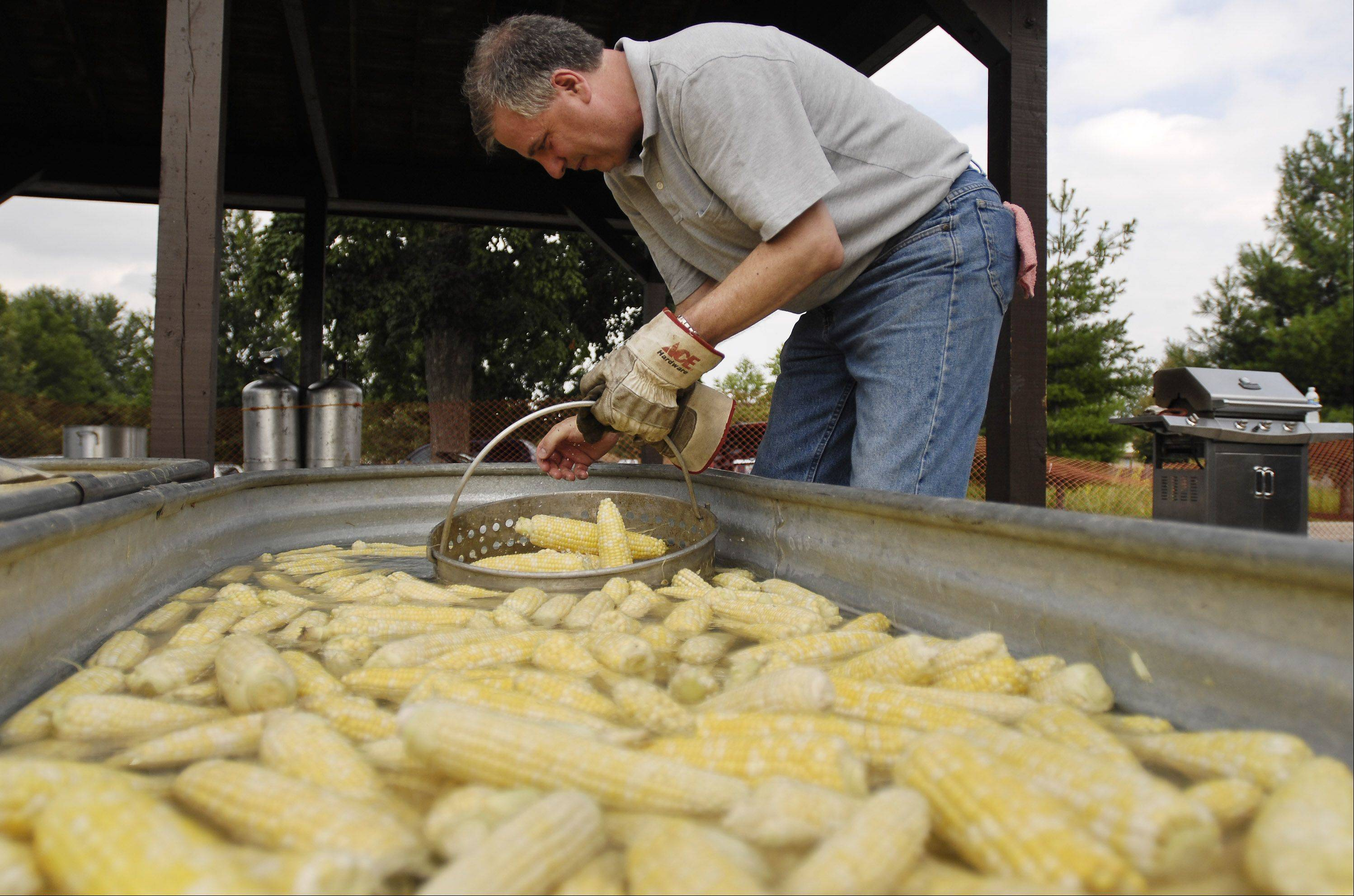 Dave Burroughs cooks up a batch of bicolor sweet corn at a previous Sugar Grove Corn Boil. Organizers estimate they�ll cook up 11,000 ears this weekend.