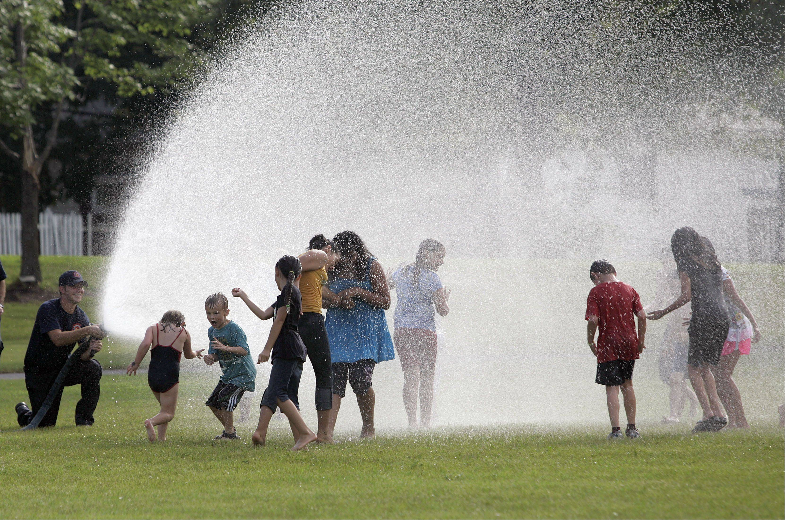 Kids keep cool at last year�s National Night Out event in Vernon Hills.