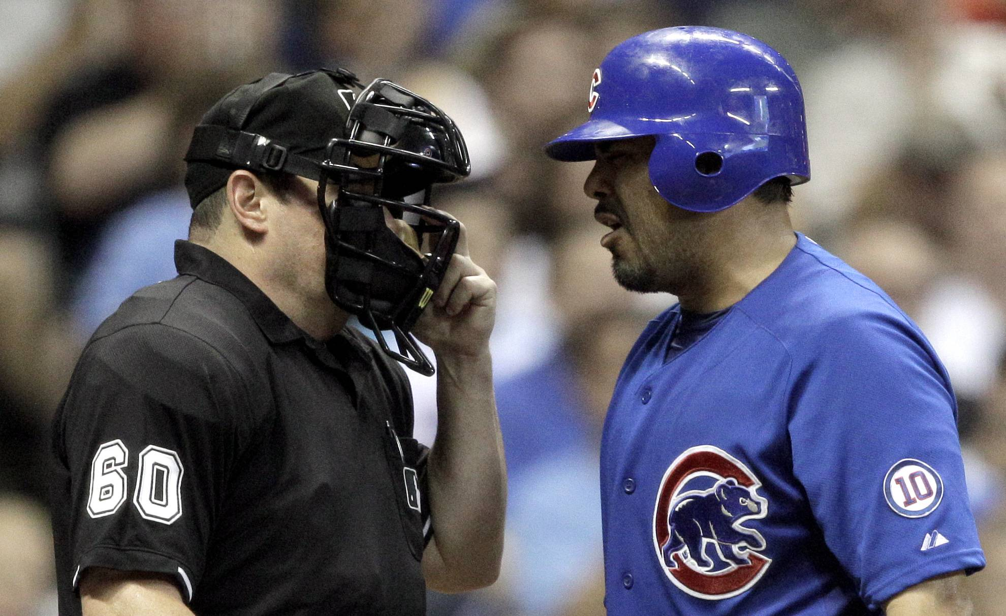 Geovany Soto argues with home plate umpire Marty Foster after a strike three call during the fourth inning Wednesday night in Milwaukee.