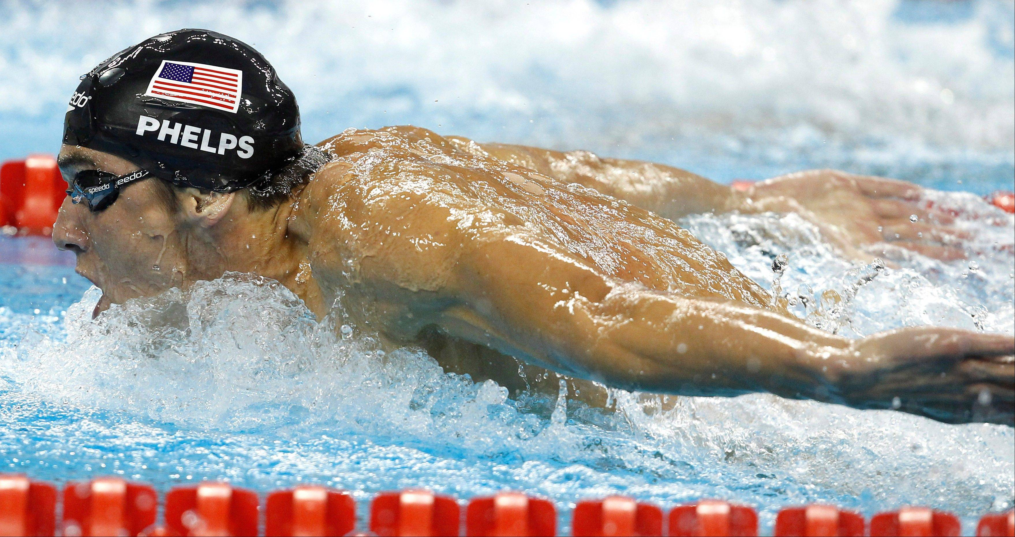 Michael Phelps heads for victory in the 200-meter butterfly at the swimming world championships in Shanghai on Wednesday.