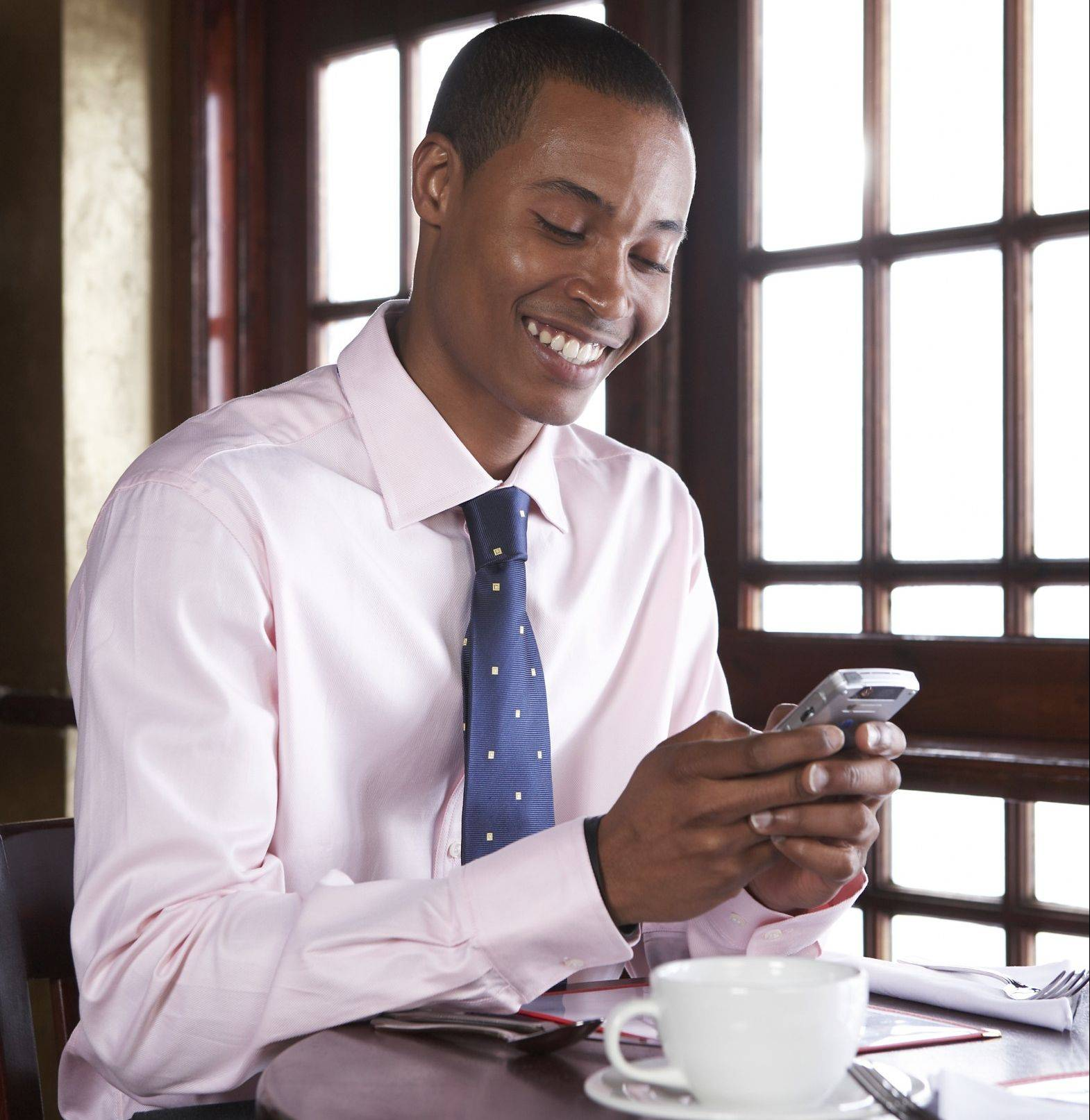 Texting or tweeting is considered an etiquette no-no when dining out.