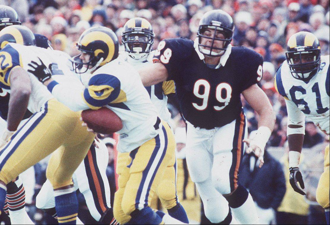 Former Bear Dan Hampton, shown here recording a sack against the Rams in 1986, said he suffered a few concussion-like symptoms in his career but didn't report them. Now, he said, times have changed.